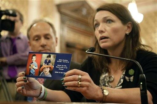 Nicole Hockley, a parent who lost her child, Dylan Hockley, 6, in the Sandy Hook school shooting in Connecticut, testifies on assault weapon legislation during a Senate Executive Committee hearing at the Illinois State Capitol Monday, May 20, 2013, in Springfield.