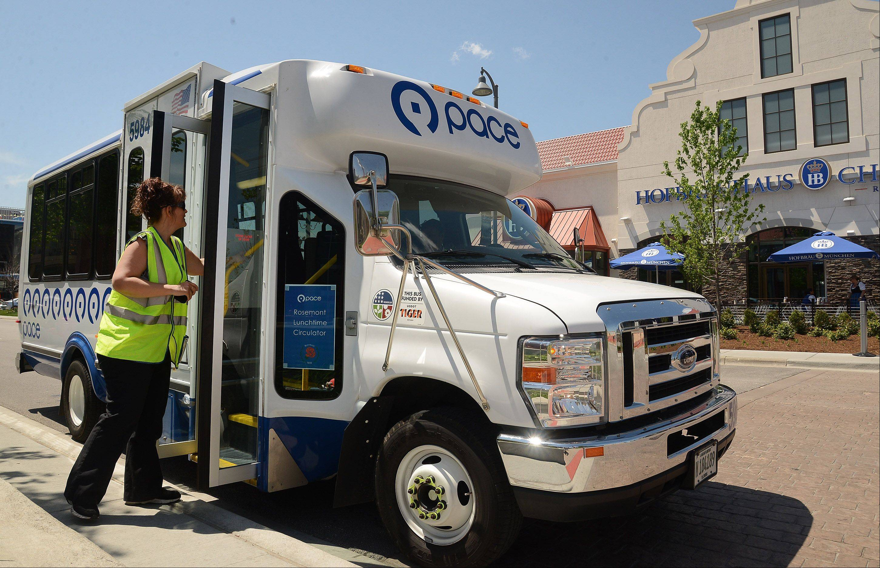 Shannon Borst of First Transit talks with driver Vanessa Pyles as one of two Pace Rosemont Lunchtime Circulator's make their rounds through the MB Financial Park at Rosemont entertainment district. The free service launched Monday.