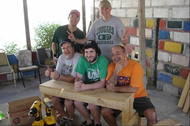 Seated, from left, Brian Reynolds is in Haiti with Ethan, his brother-in-law the Rev. Bob Butler, and, standing, Rick Ruelo and Rod Kingzette.