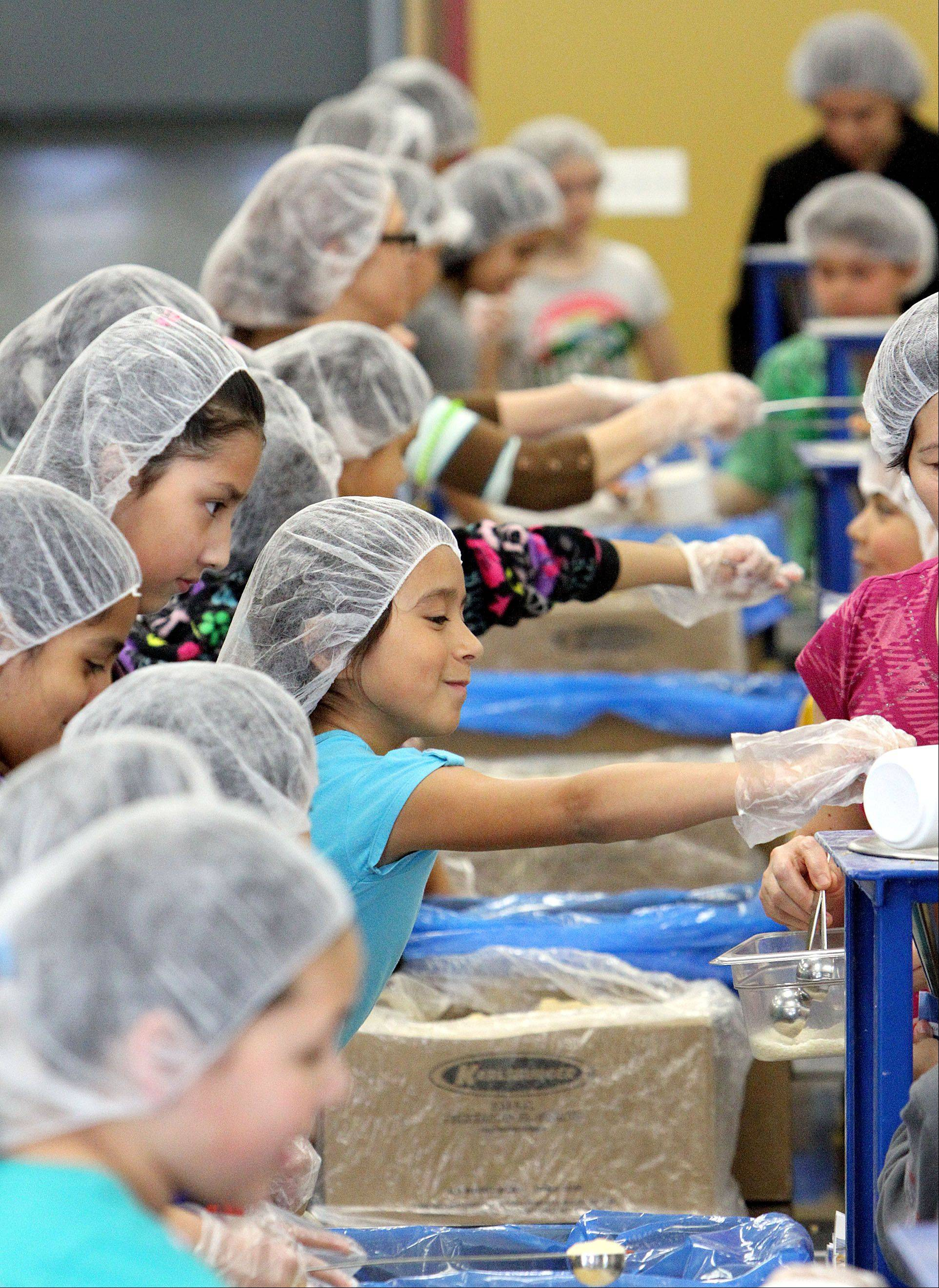 Around 100 fourth-grade students and parents from W.J. Murphy School in Round Lake packed meals a Libertyville's Feed My Starving Children in April.