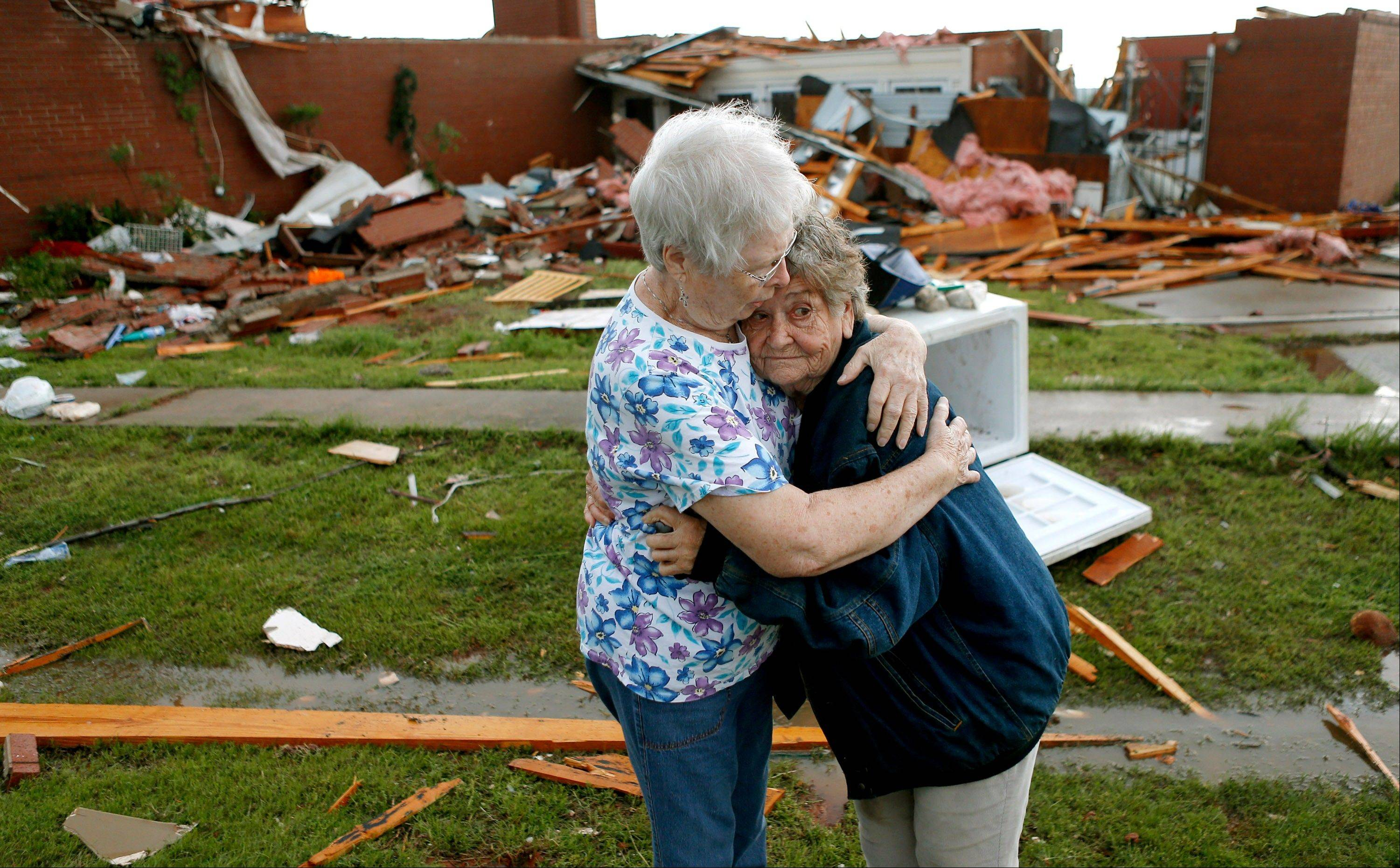 Jerry Dirks, at right, hugs her friend Earlene Langley after a tornado hit Driks' home just south of Carney Okla., on Sunday, May 19, 2013. Dirks was in her cellar at the time the tornado hit.