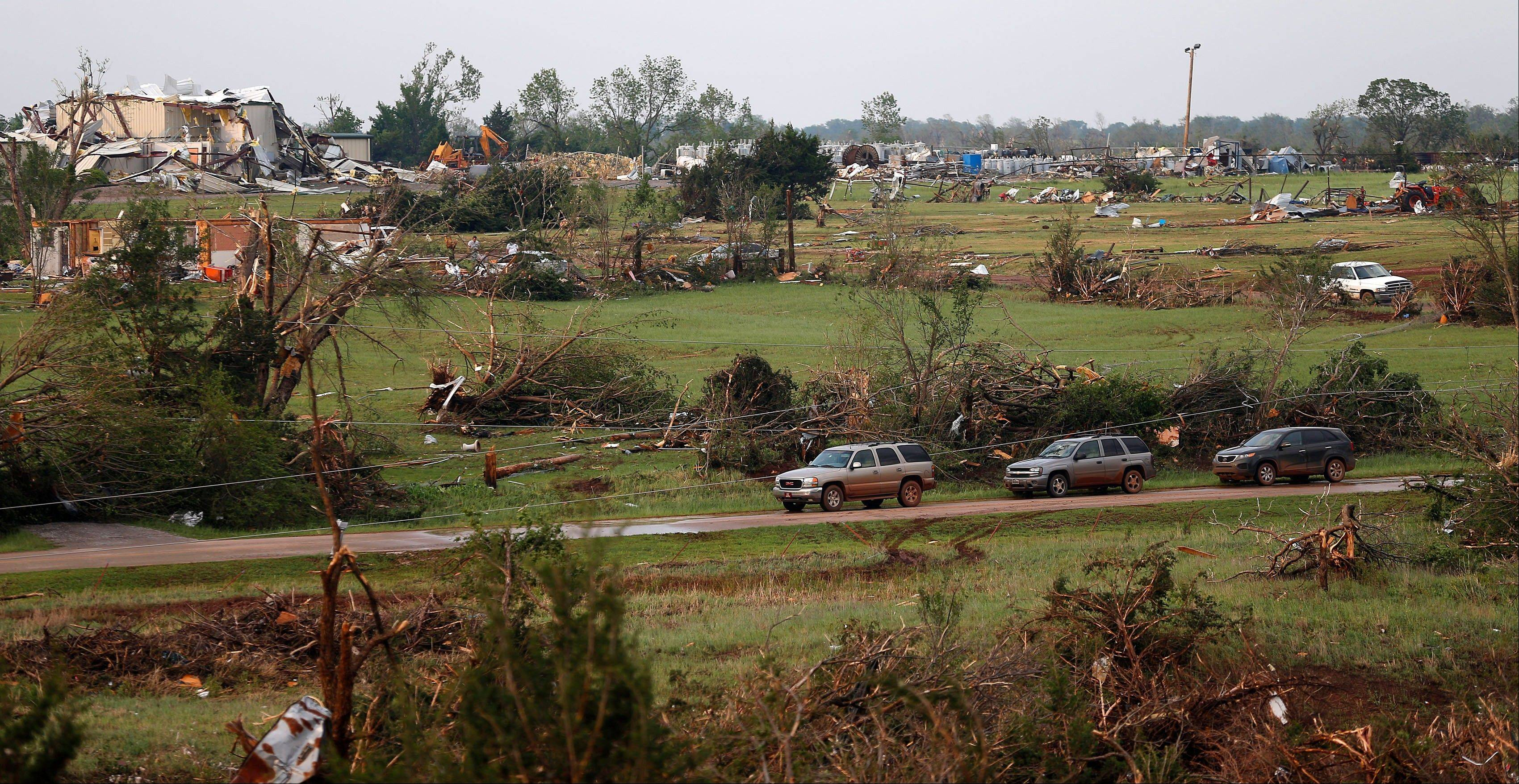 Damaged homes are seen in Carney, Okla., on Sunday, May 19, 2013, after a tornado moved through the area. Damaged homes are seen in Carney, Okla., on Sunday, May 19, 2013, after a tornado moved through the area.