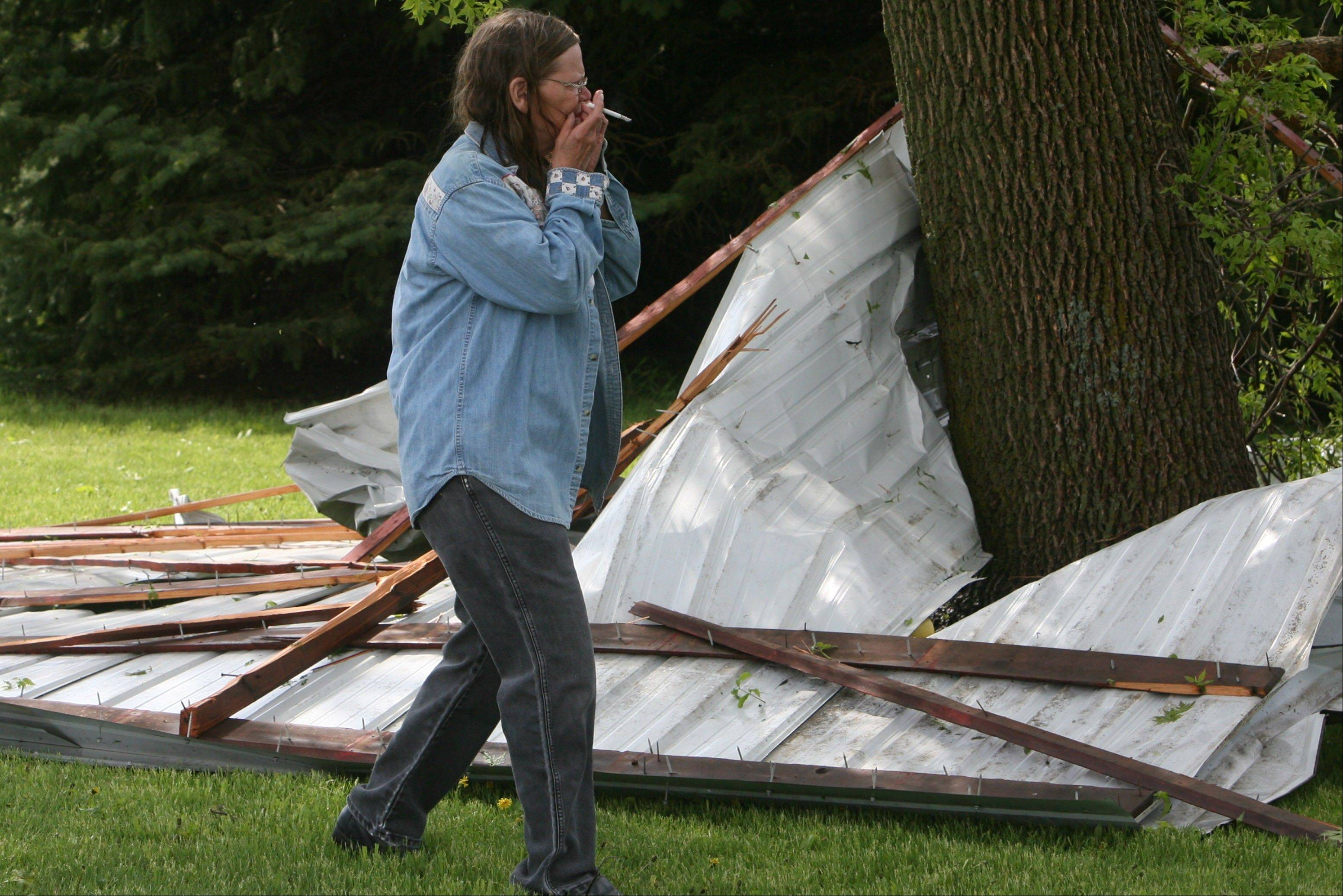 June McFarland reacts to the first sight of storm damage in rural Osage, Iowa on Sunday, May 19, 2013. A powerful weather system moved through the area on Sunday afternoon triggering tornado warnings, high winds and hail.