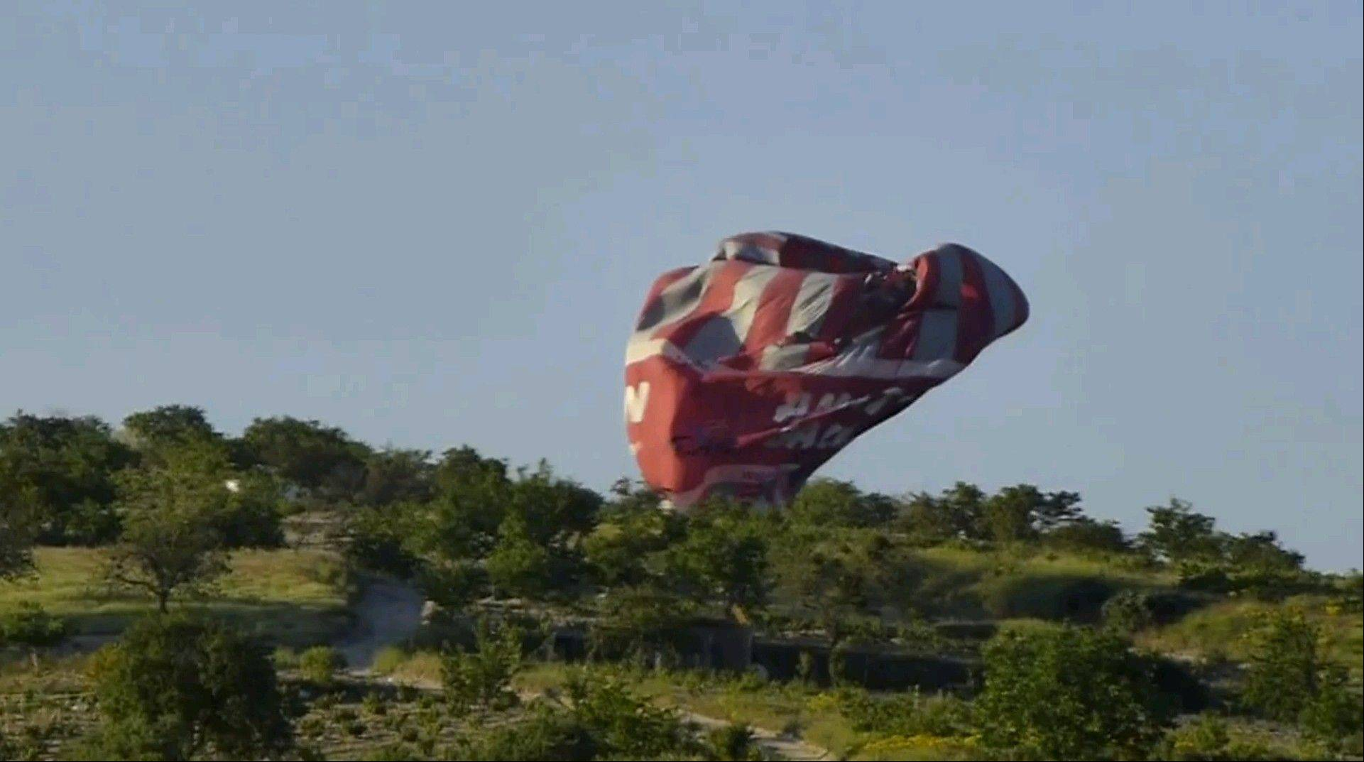 Two hot air balloons collided in midair during a sightseeing tour of volcanic rock formations in Turkey on Monday, causing one of them to crash to the ground, officials said. One Brazilian tourist was killed while 24 other people on board were injured.
