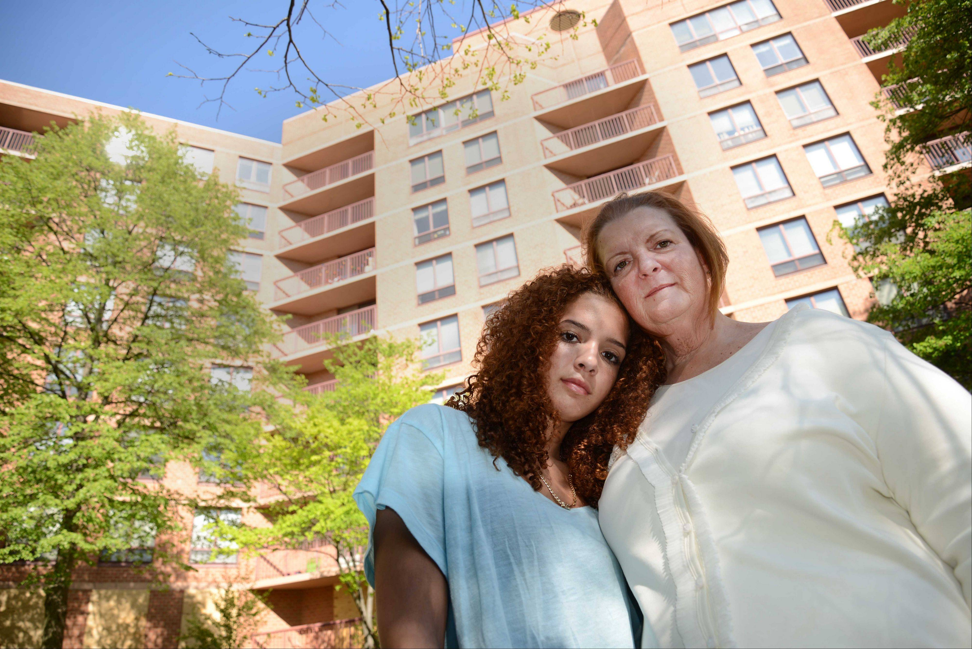 Towers at Four Lakes resident Debra Schulz and her 15-year-old daughter, Haleigh, can't move back into their eighth-floor home until June 15, nearly two months after flooding destroyed the building's electrical system.