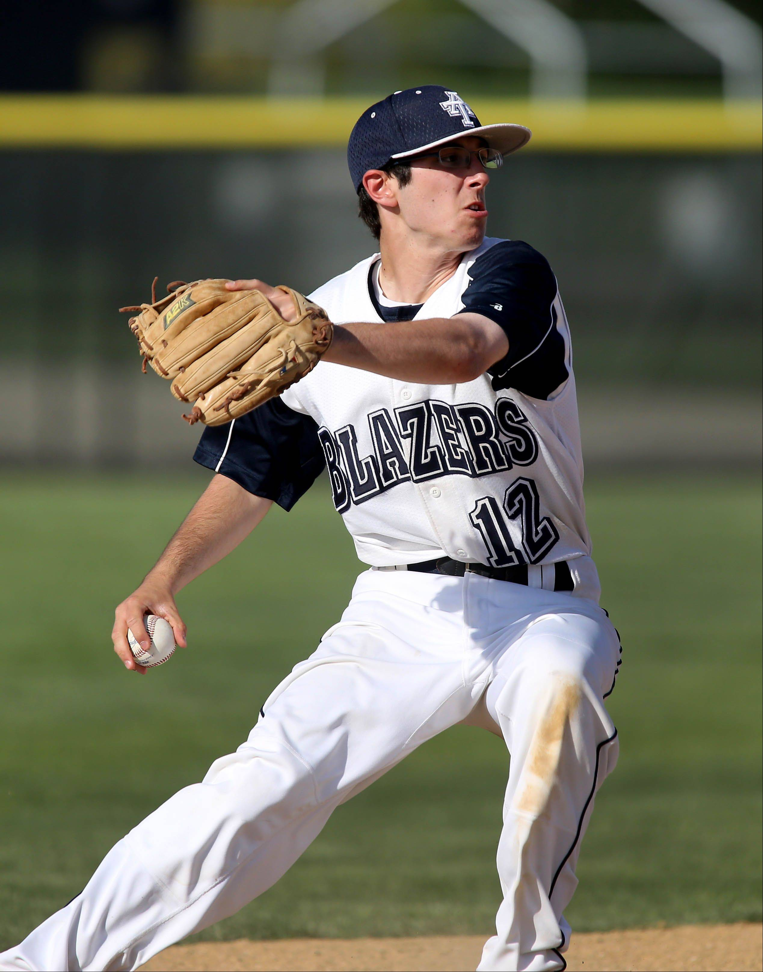 Joe Amato of Addison Trail throws to first in against Streamwood in baseball action on Monday in Addison.