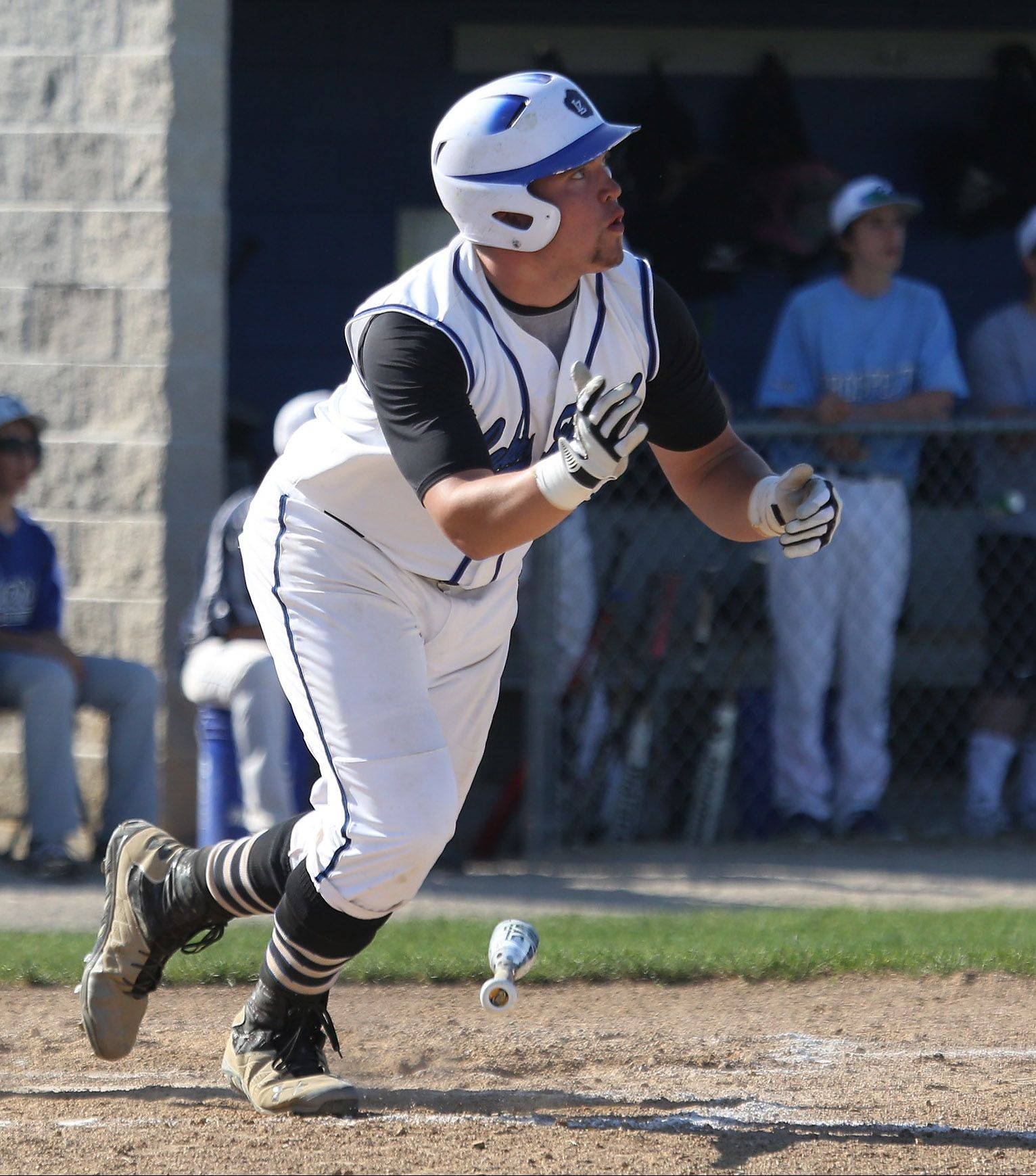 Lake Zurich's Tanner Kizer watches the ball clear the fence on a 3-run homer in the first inning during Monday's regional contest against visiting Prospect.