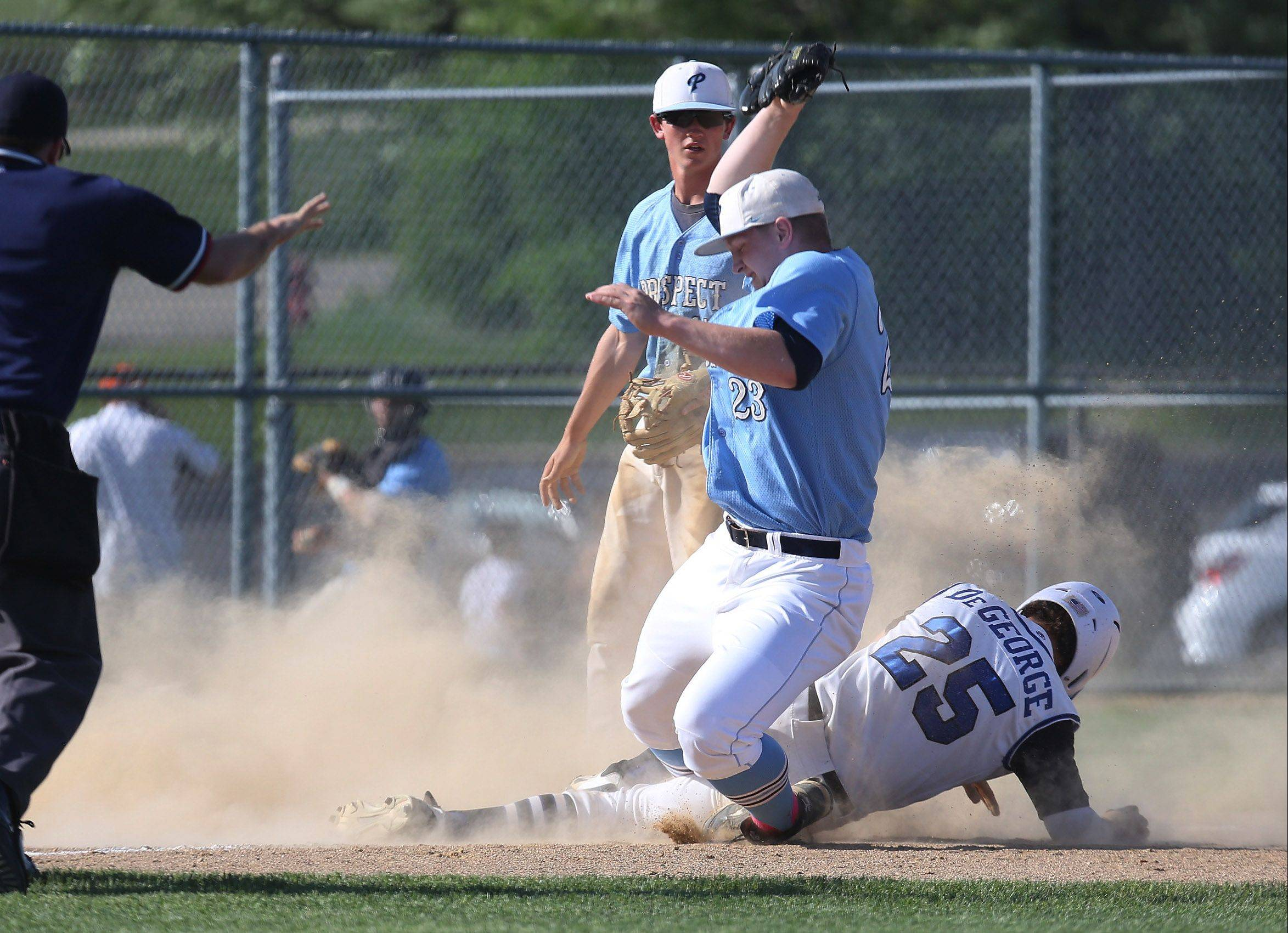 Lake Zurich's James DeGeorge slides safely into third base under the tag of Prospect pitcher Welby Malczewski in the first inning Monday at LZ.