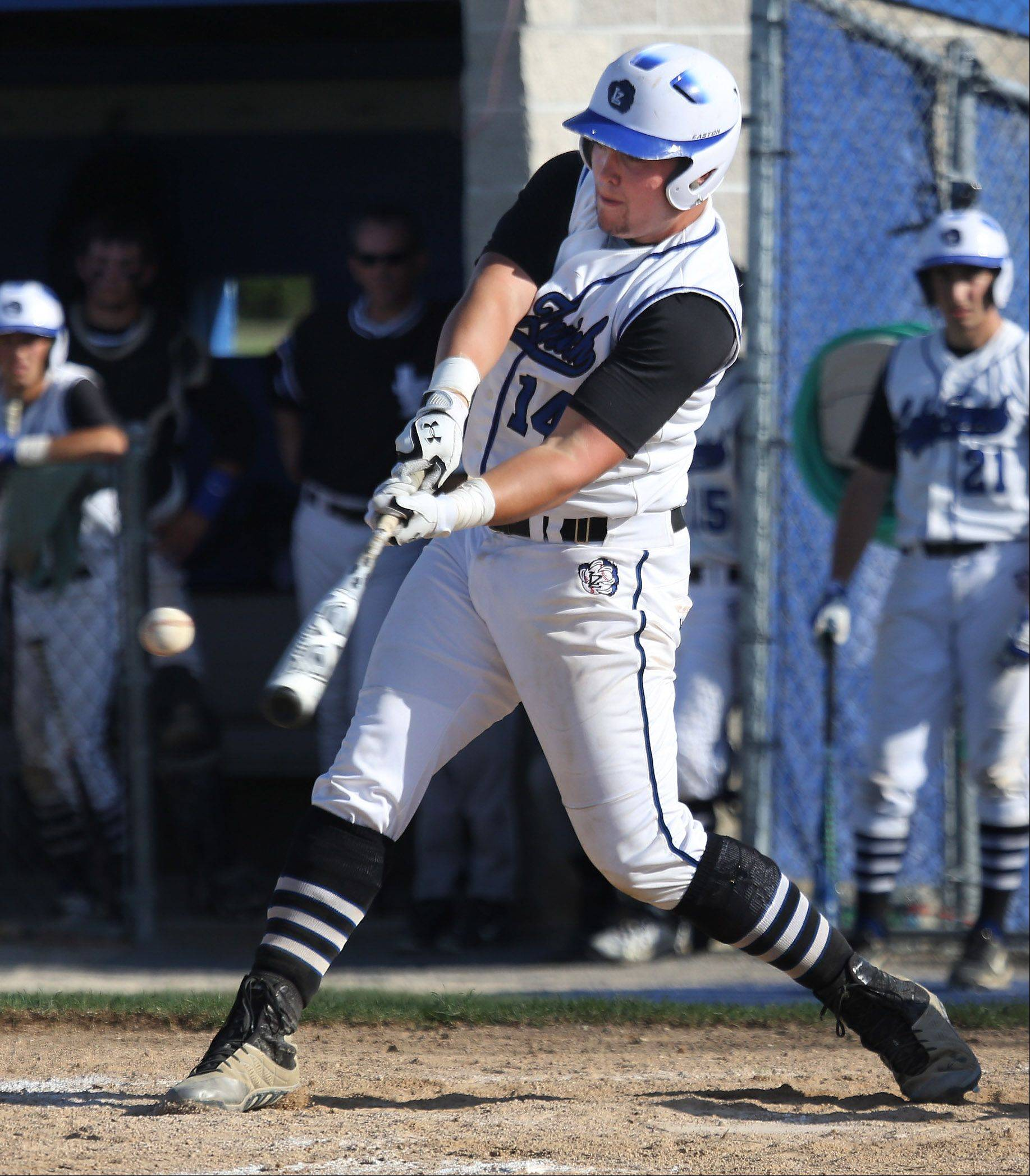Lake Zurich hitter Tanner Kizer delivers a 2-run triple in the second inning against visiting Prospect in Class 4A regional play Monday.