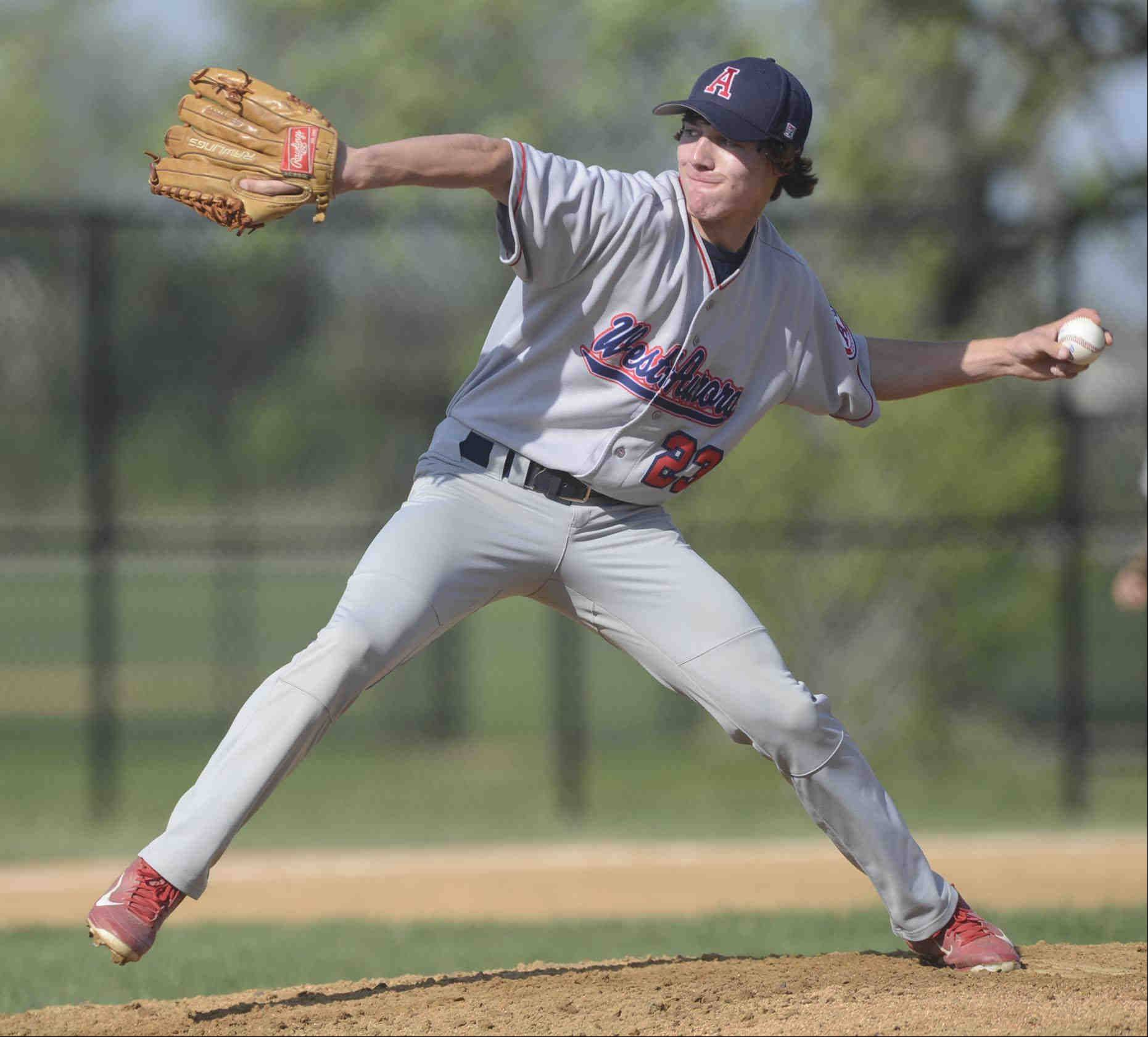 West Aurora starting pitcher Seth Palmby delivers against Marmion Academy Monday in Aurora.