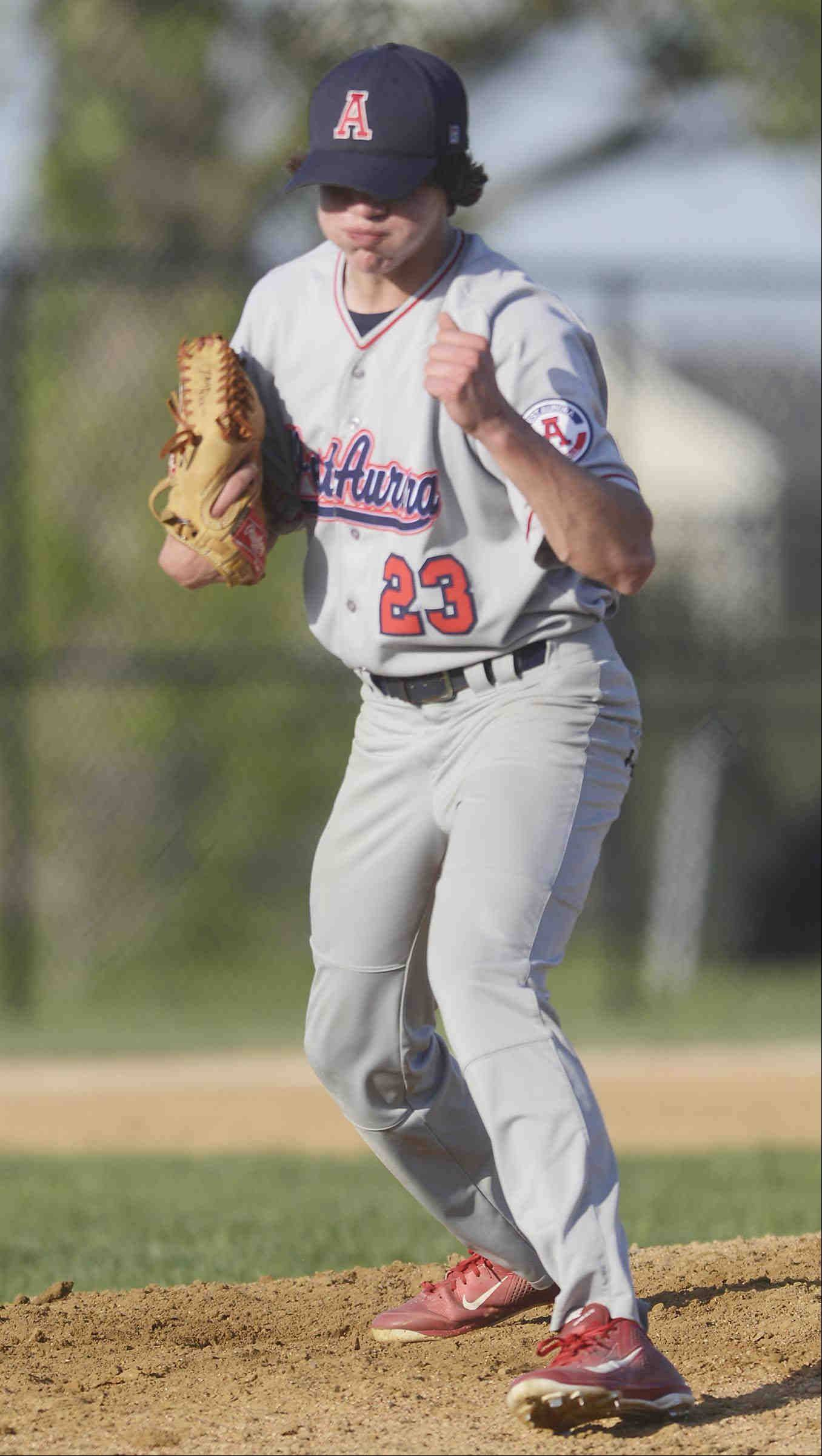 West Aurora pitcher Seth Palmby reacts at striking out the last Marmion Academy batter to win Monday in Aurora.