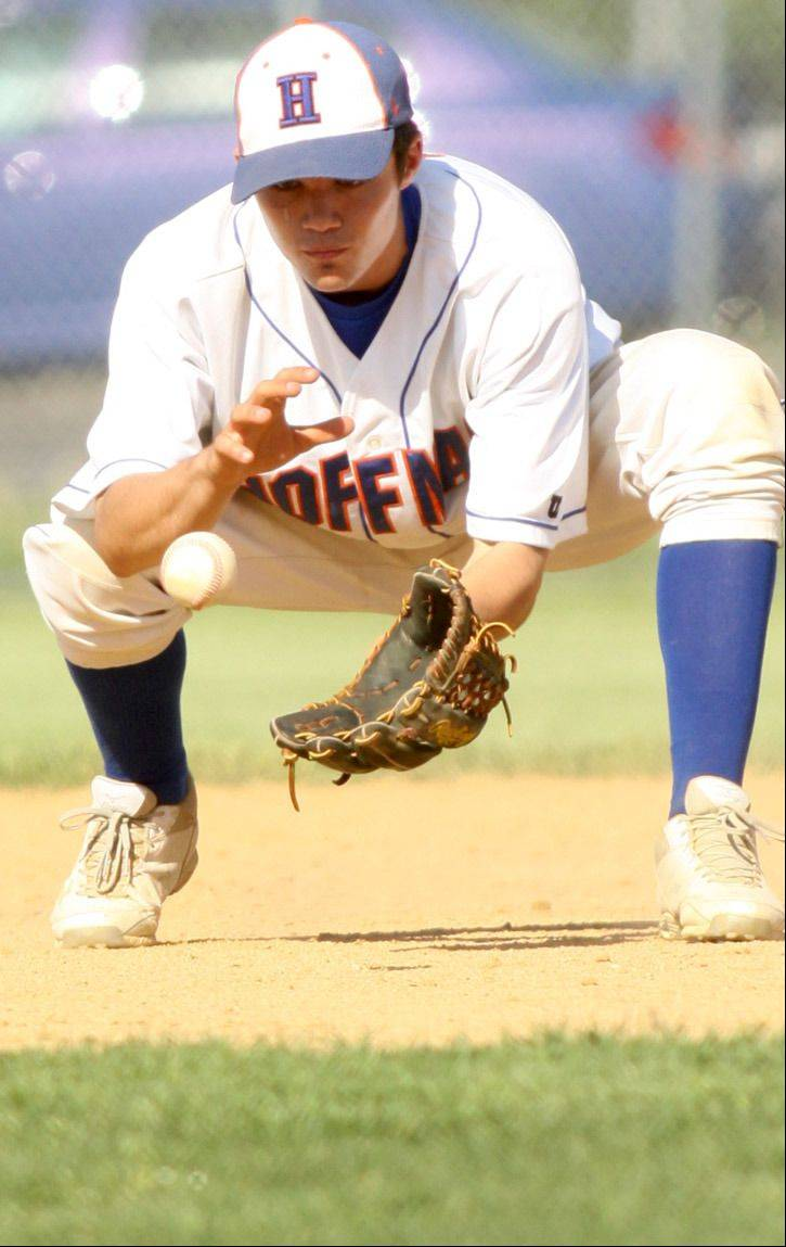 Hoffman Estates' Trevor Pye tracks a hot grounder before firing to first for an out during a varsity baseball game at Elgin on Monday night.