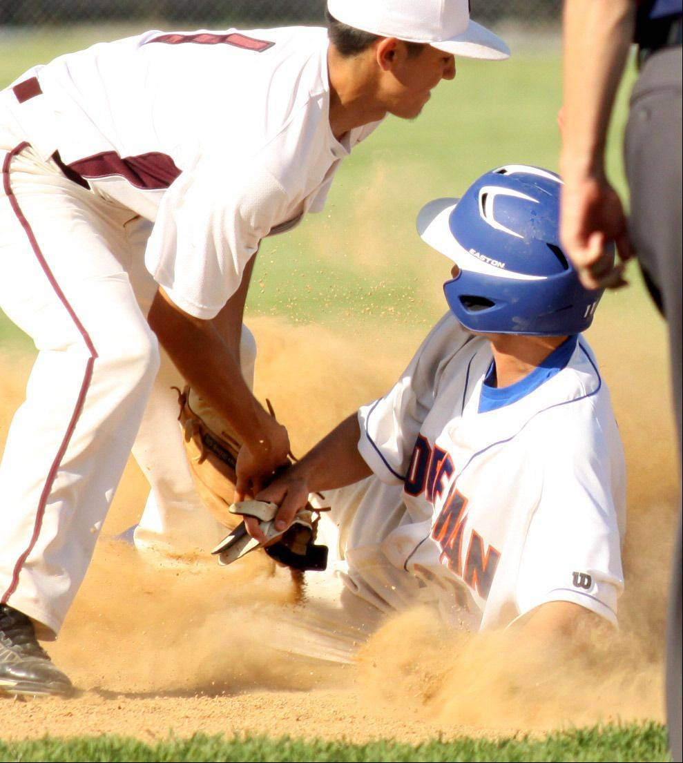 Elgin's Omar Valadez applies a tag as Hoffman Estates' Trevor Pye is caught trying to steal second base at Elgin on Monday.