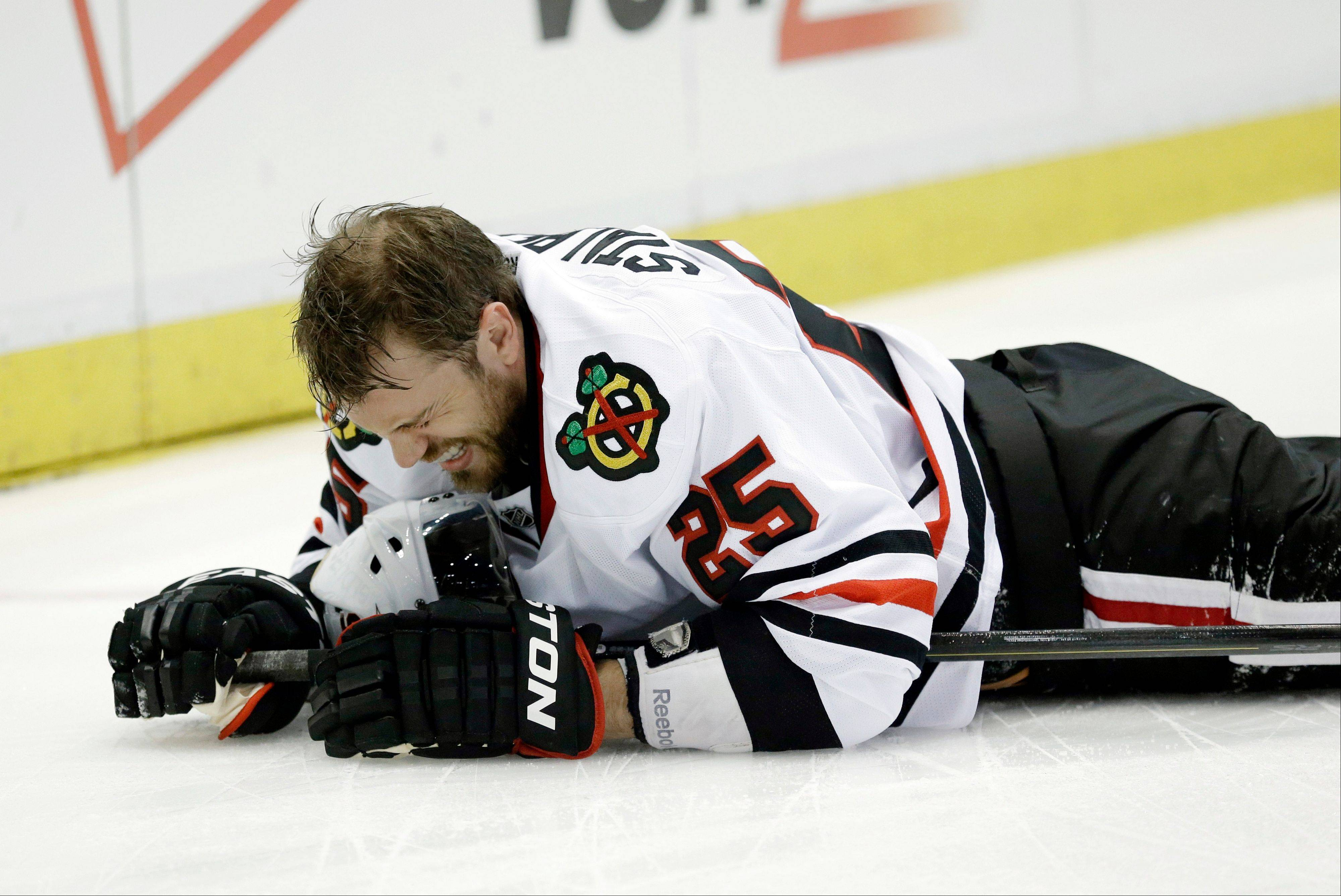 Chicago Blackhawks left wing Viktor Stalberg (25), of Sweden, grimaces after hitting the wall during the first period of an NHL hockey Stanley Cup playoffs Western Conference semifinal game against the Detroit Red Wings in Detroit, Monday, May 20, 2013.