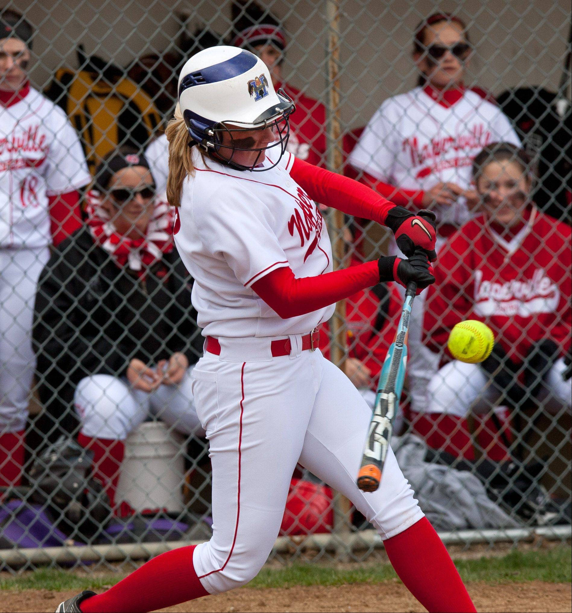 Naperville Central's Megan Nerger doubles home a run against Neuqua Valley during girls softball action.