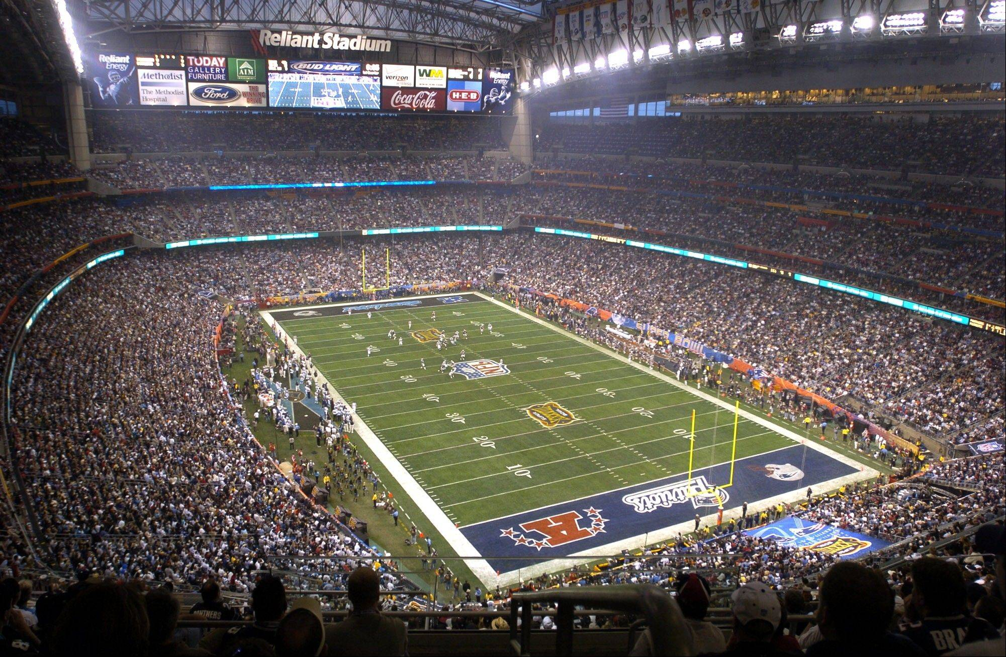 In this Feb. 1, 2004 file photo,�Houston's Reliant Stadium hosts a sellout crowd at Super Bowl XXXVIII between the Carolina Panthers and the New England Patriots in Houston. NFL owners will vote on the sites of the 50th and 51st Super Bowls on Tuesday, May 21, 2013 at their spring meetings. The San Francisco area, where a new stadium is being built in Santa Clara, and South Florida are competing for the the 50th edition, to be held in February 2016.