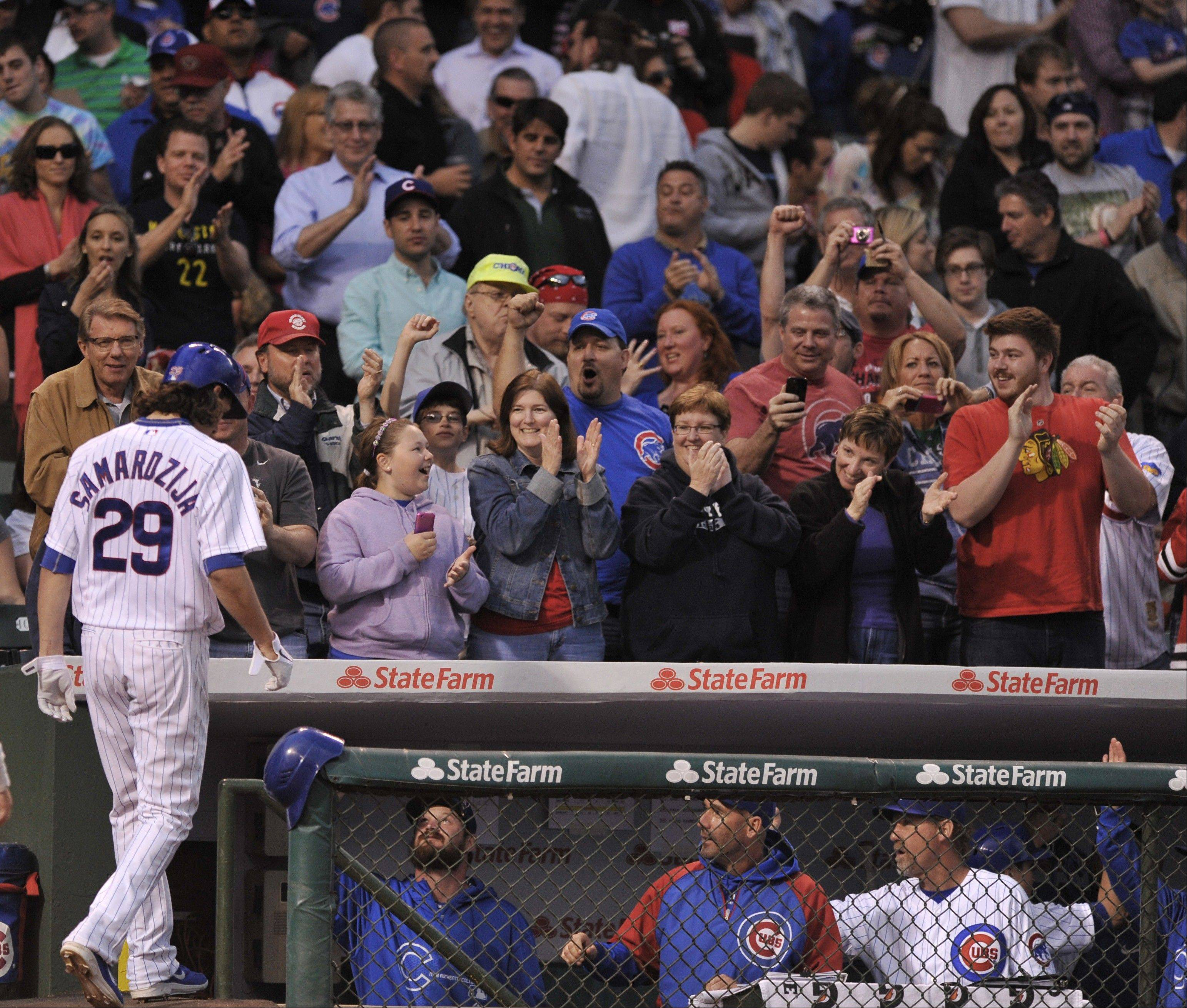Starting pitching has kept the Cubs in games this season, and fans shown here appreciate everything Jeff Samardzija has given, including a two-run home run against the Colorado Rockies last week.