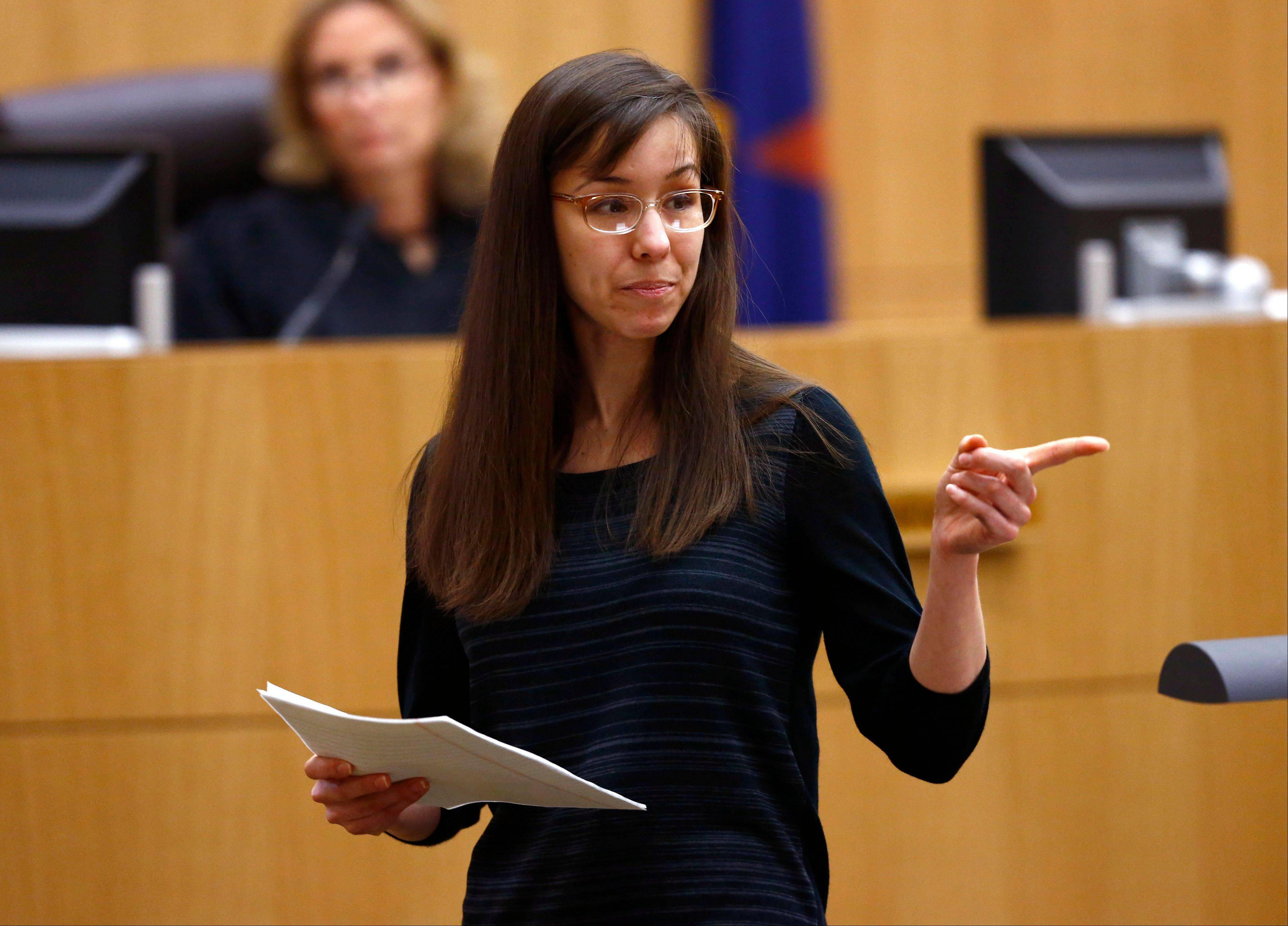 Jodi Arias points to her family as a reason for the jury to give her a life in prison sentence instead of the death penalty on Tuesday during the penalty phase of her murder trial at Maricopa County Superior Court in Phoenix. Arias was convicted of first-degree murder in the stabbing and shooting to death of Travis Alexander, 30, in suburban Phoenix.