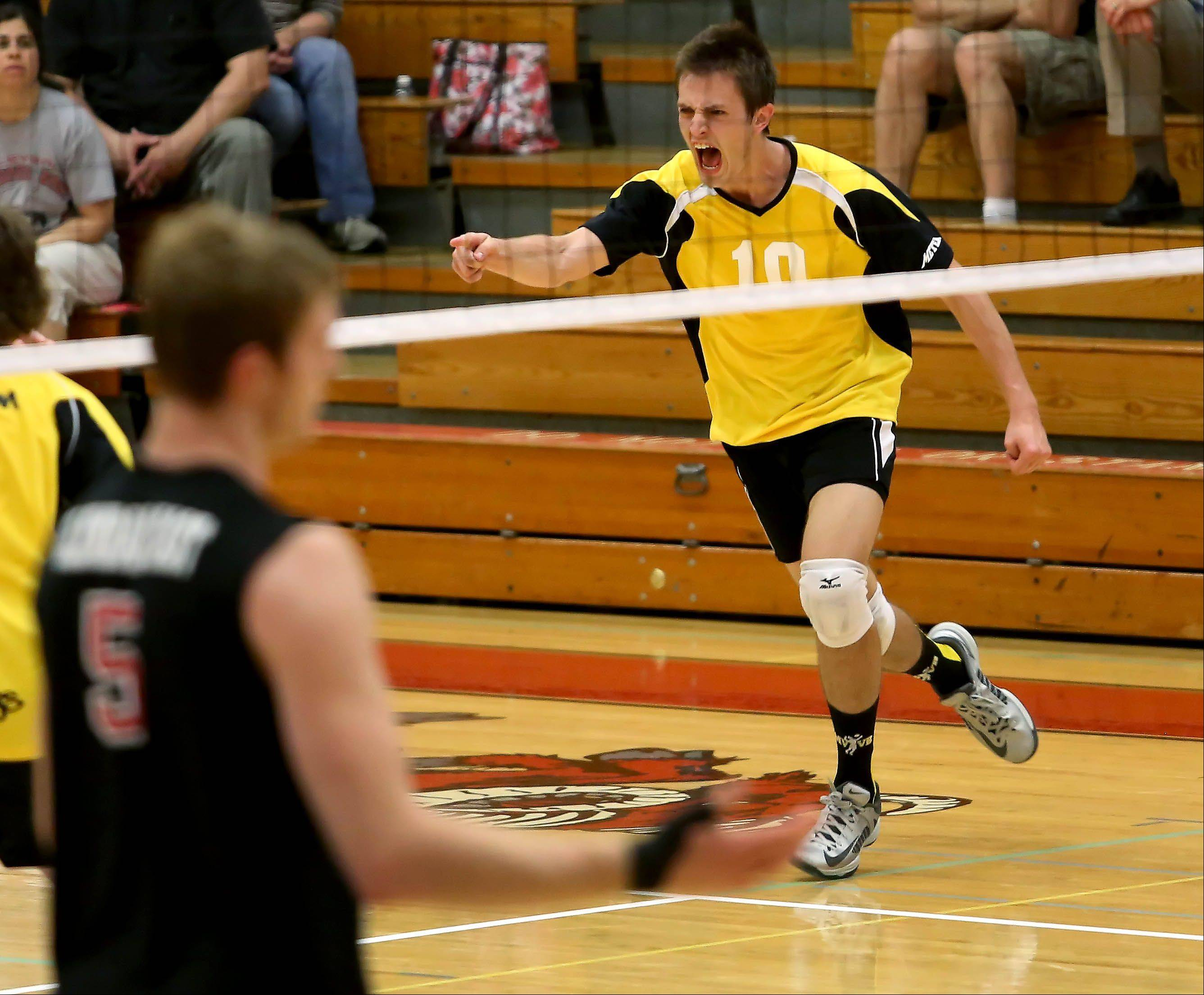 Martin Krasuski of Metea Valley reacts to a point won against Glenbard East in boys regional volleyball action in Lombard in Tuesday. Metea Valley won 2-0.