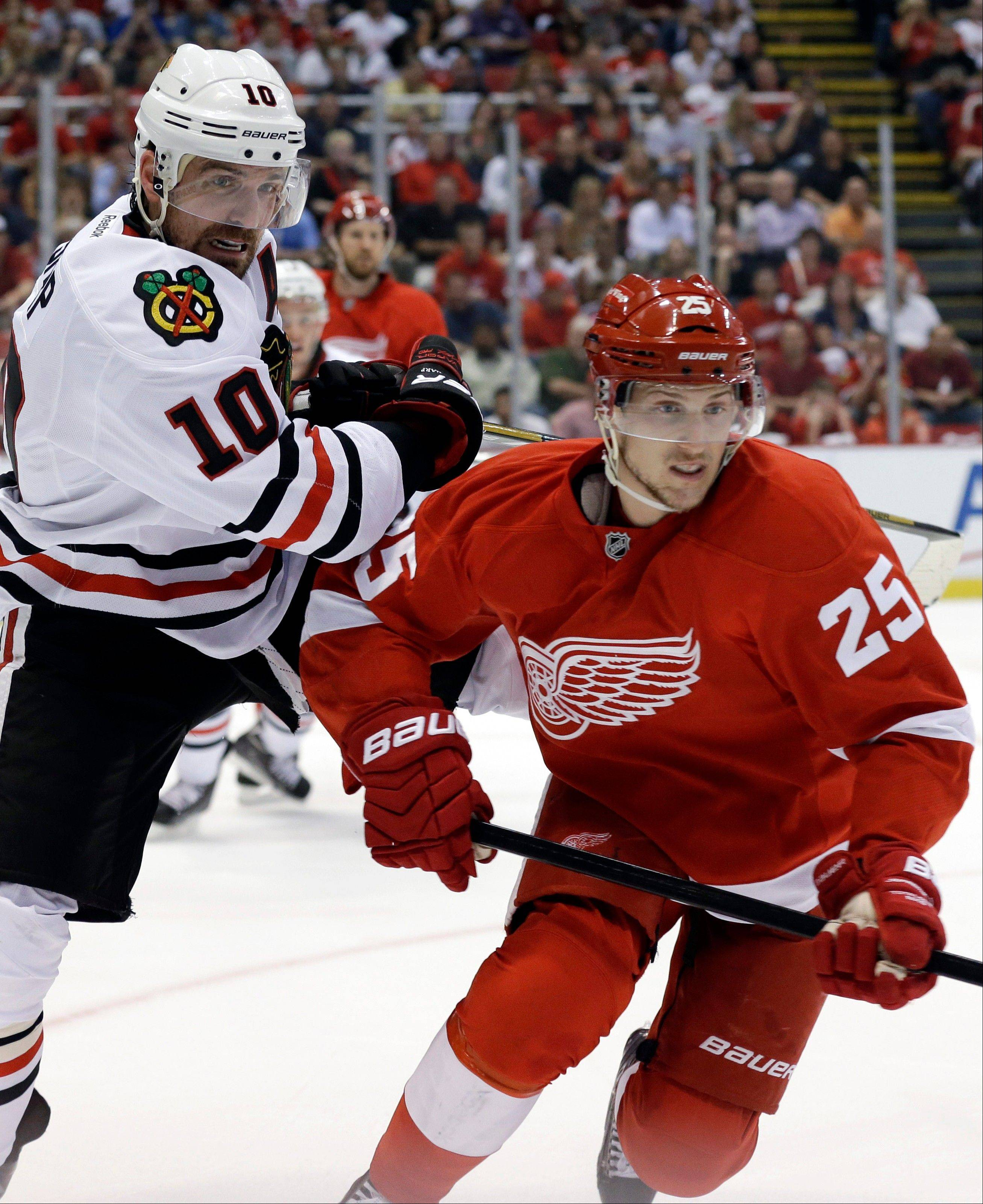 Blackhawks winger Patrick Sharp, here battling Detroit center Cory Emmerton for the puck in Game 3, says every playoff game is huge. But Game 4 in this series is even bigger than most.