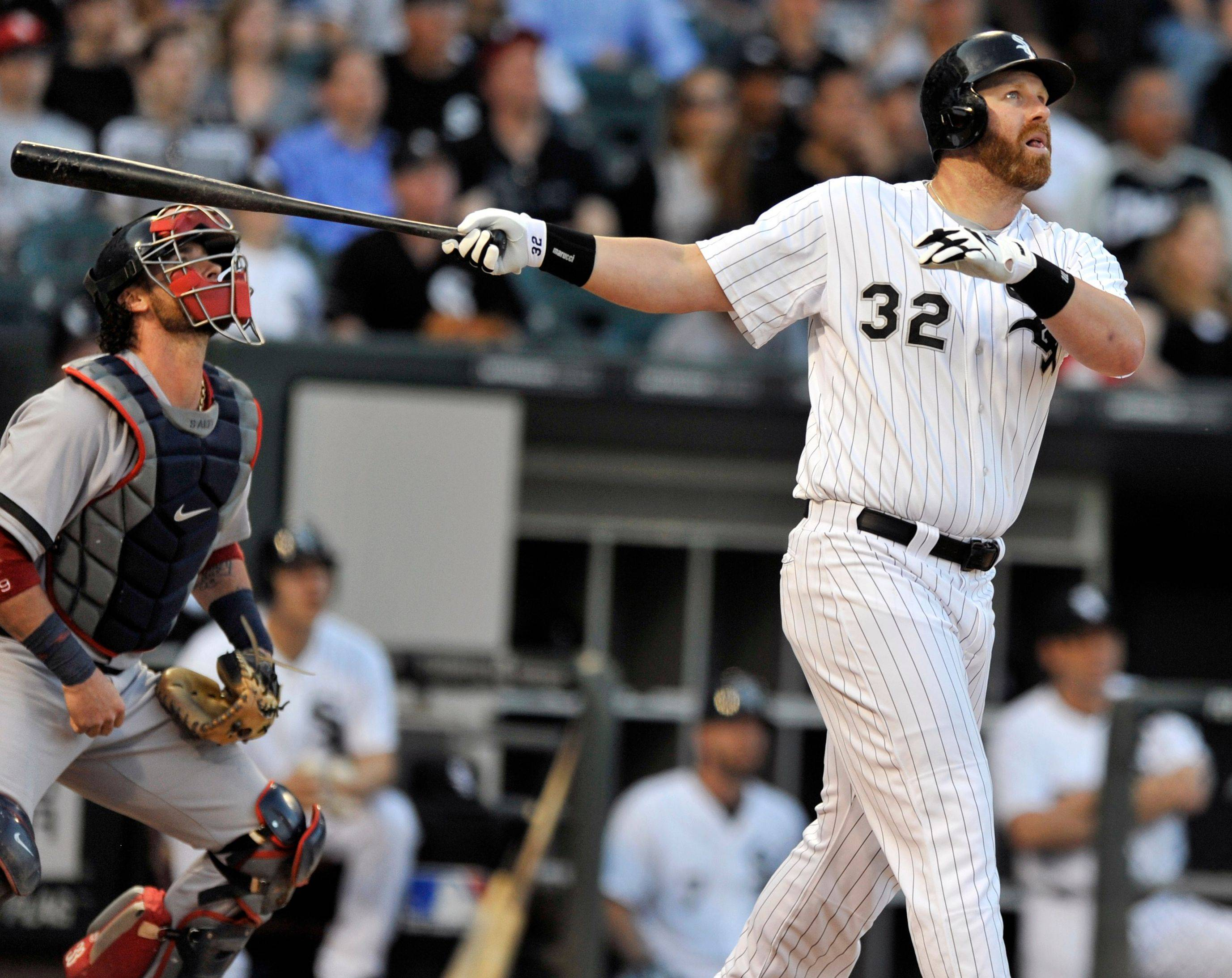 Adam Dunn watches his 3-run home run during the first inning Monday night at U.S. Cellular Field. It was Dunn's 11 home run of the year.
