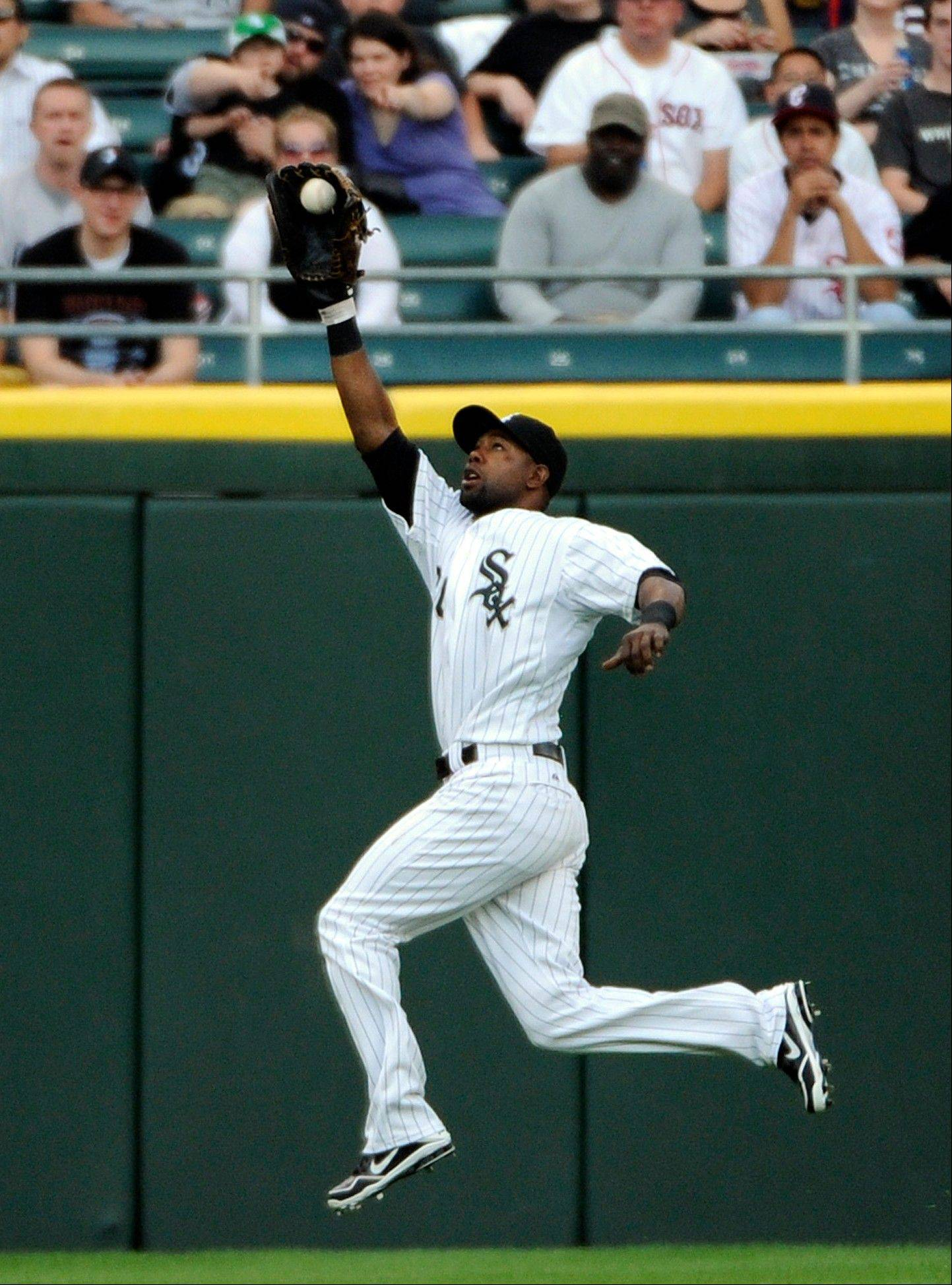 White Sox center fielder Alejandro De Aza makes a leaping catch on a ball hit by the Red Sox' Jacoby Ellsbury in the first inning Tuesday at U.S. Cellular Field.