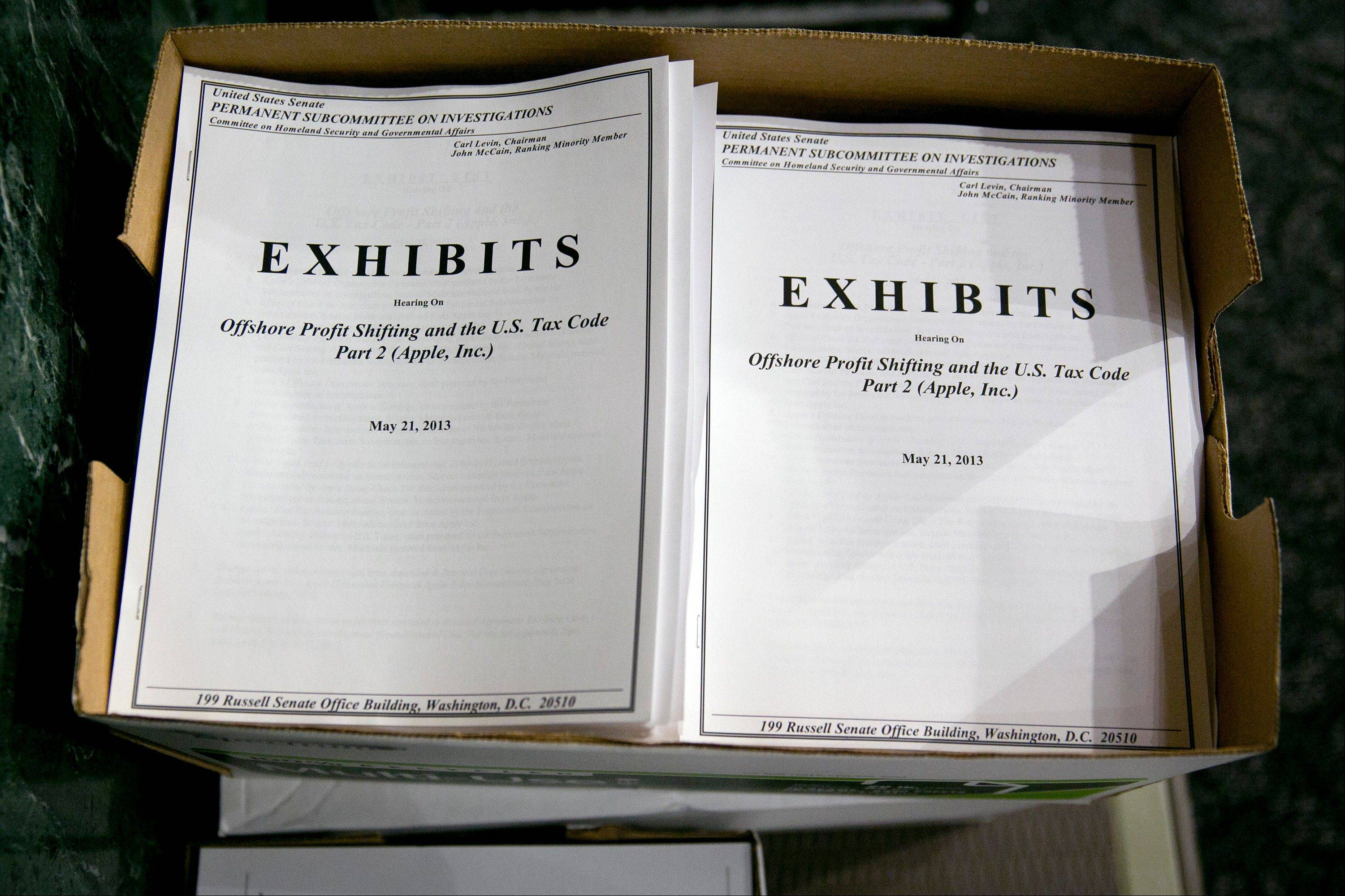 An exhibits booklet for the Senate Permanent Subcommittee on Investigations hearing titled Offshore Profit Sharing and the U.S. Tax Code Part 2 (Apple Inc.) sits in the hearing room in Washington, D.C., U.S., on Tuesday, May 21, 2013.