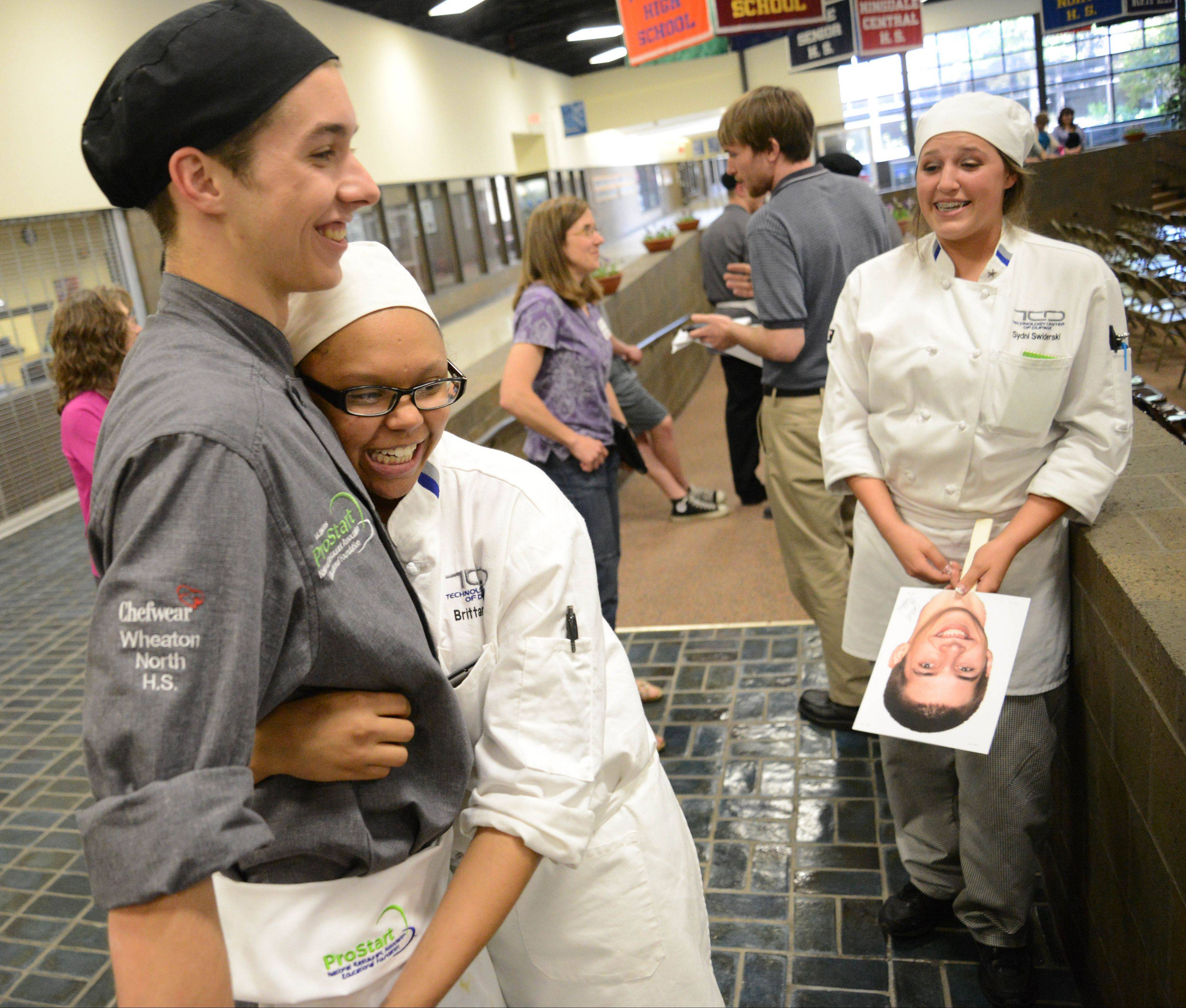 Zachary Molokie of Carol Stream gets a hug from classmate Brittany Jones of Aurora after he won the local leg of The Cutting Edge Tour student culinary competition. The ultimate winner gets the opportunity to cook with chefs at the White House.