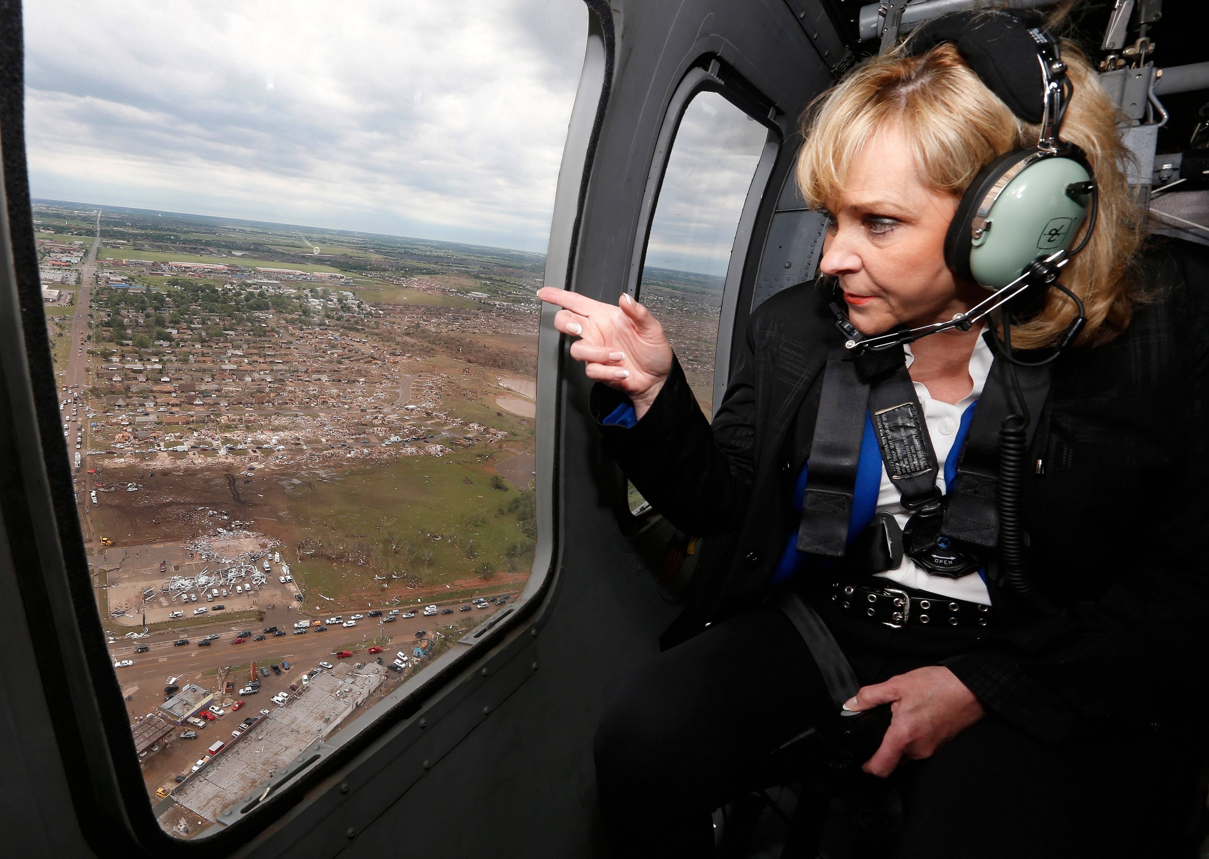 Oklahoma Gov. Mary Fallin looks out the window of a National Guard helicopter as she tours the tornado damage in Moore, Okla., Tuesday, May 21, 2013.