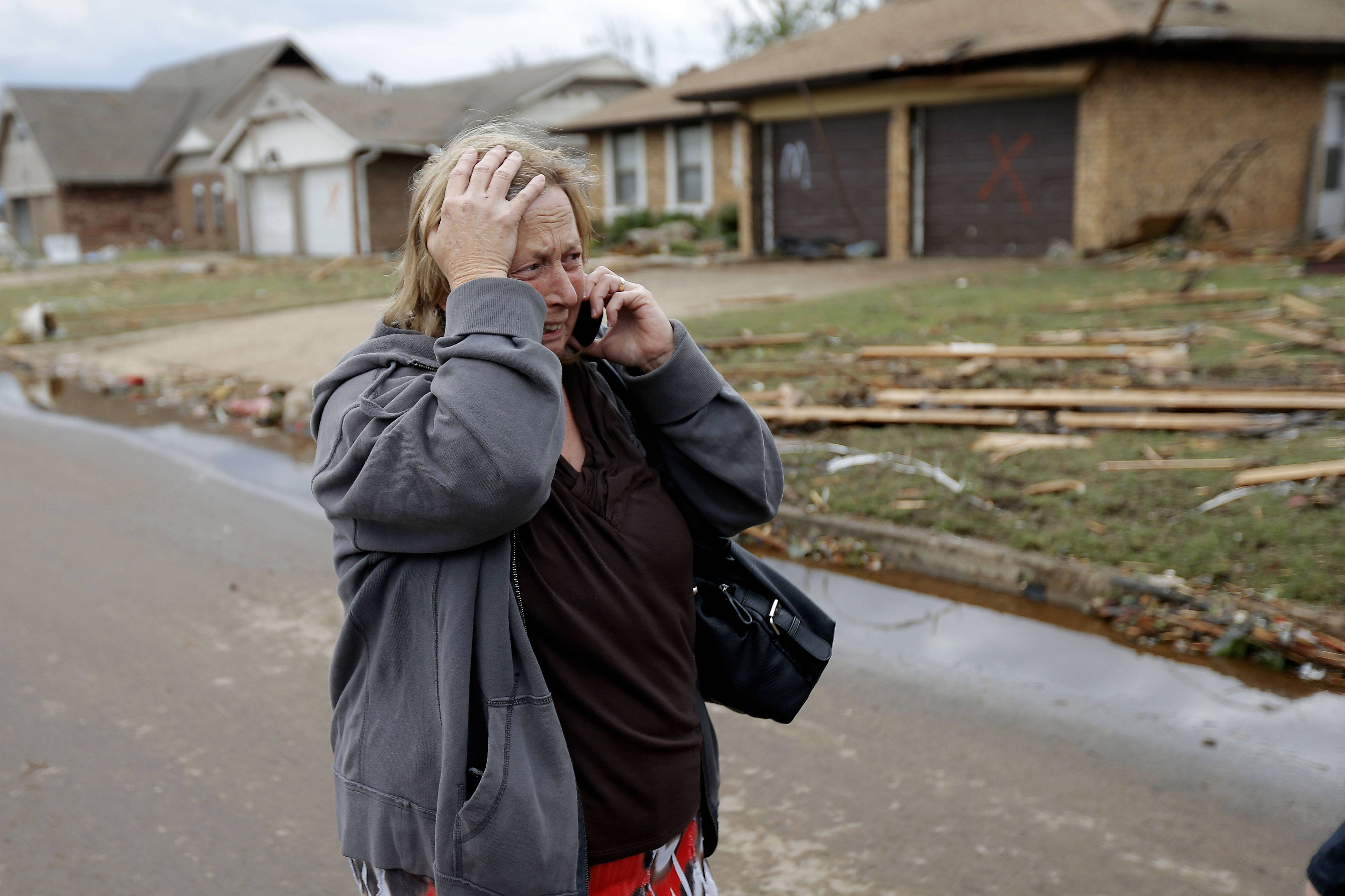 Paula McGee reacts as she sees her home on Kings Manor in Moore, Okla., on Tuesday, May 21, 2013. McGee bought the home two weeks ago and it was hit by the tornado that moved through the Moore area on Monday.