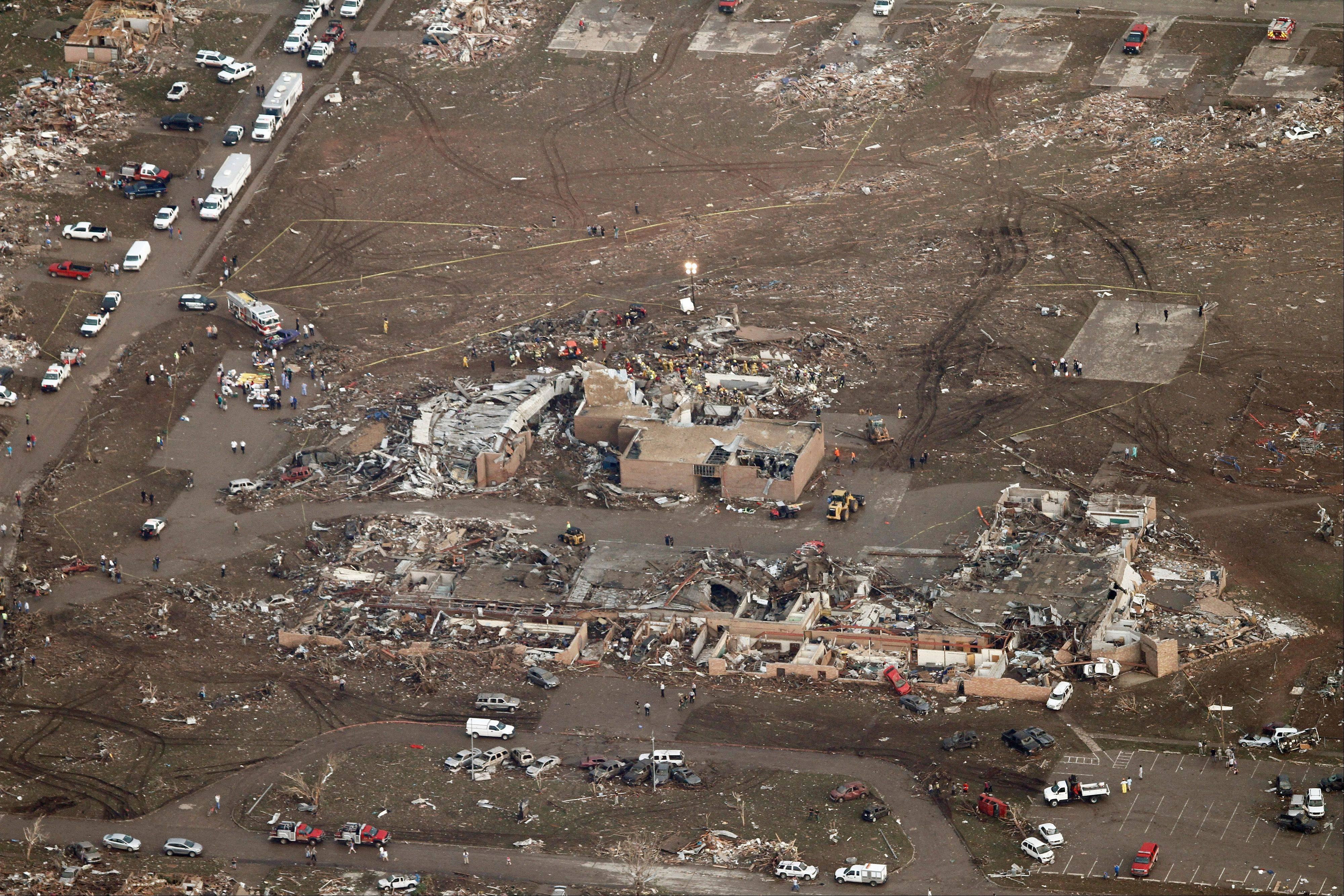 This aerial photo shows damage to Plaza Towers Elementary School after it was hit by a massive tornado in Moore, Okla., Monday May 20, 2013. A tornado roared through the Oklahoma City suburbs Monday, flattening entire neighborhoods, setting buildings on fire and landing a direct blow on an elementary school.