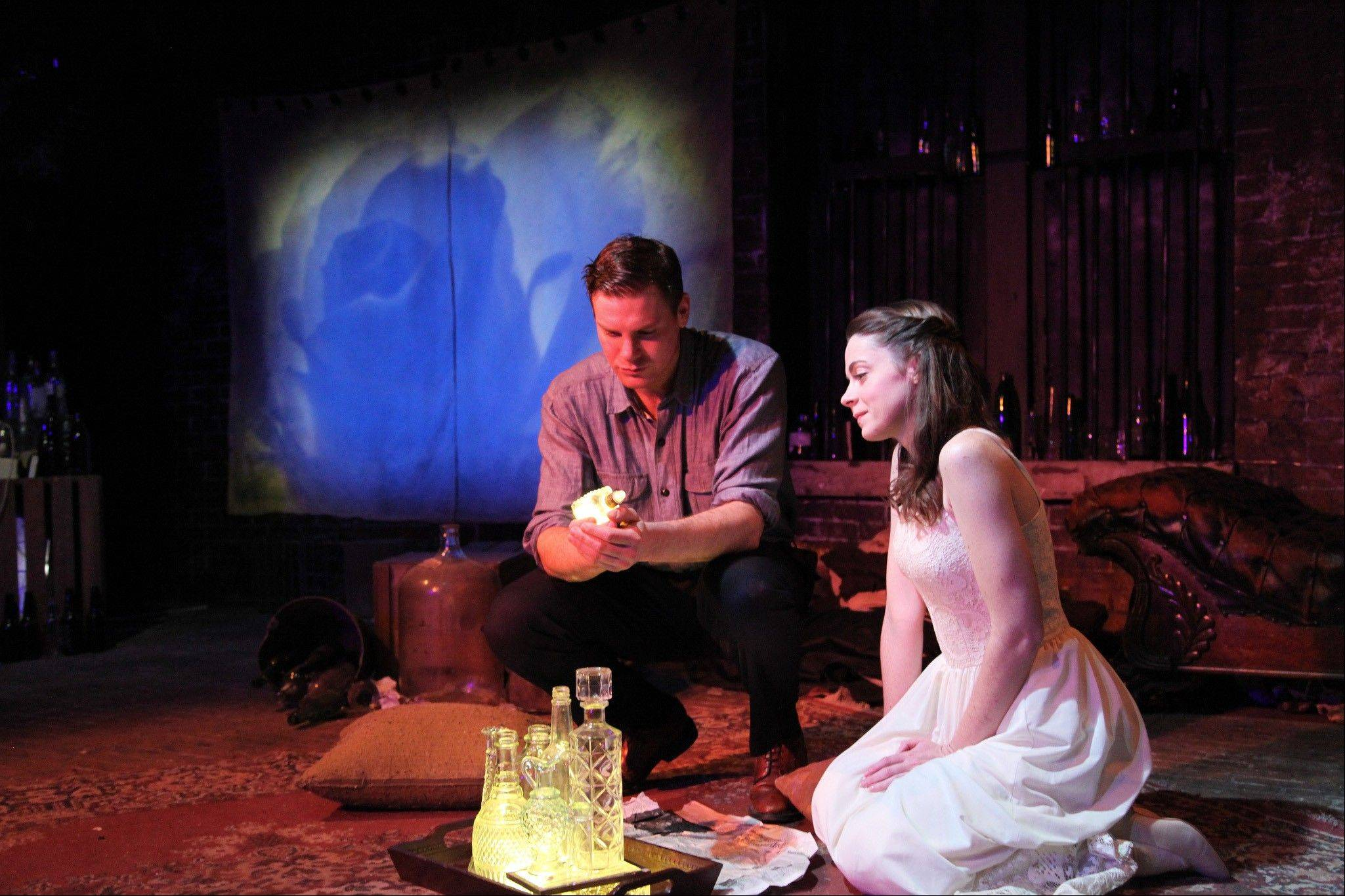 "Sharing a pivotal moment, Walter Briggs and Joanne Dubach perform a scene in a revolutionary production of Tennessee Williams' classic ""The Glass Menagerie,"" a Mary-Arrchie Theatre Co. production running through June at the Theater Wit in Chicago."