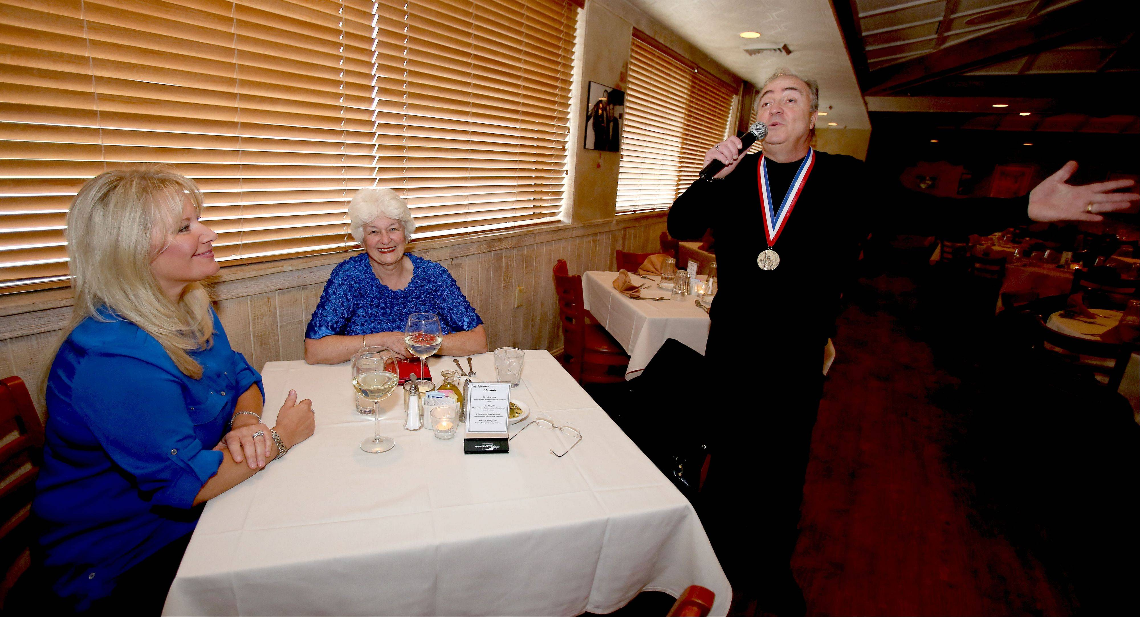 "Tony Spavone sings an Elvis song for his wife, Lynette, left, and their friend Joyce Basel. ""I'm pretty versatile,"" he said. ""I read my audience. I sing what I feel in the room."""