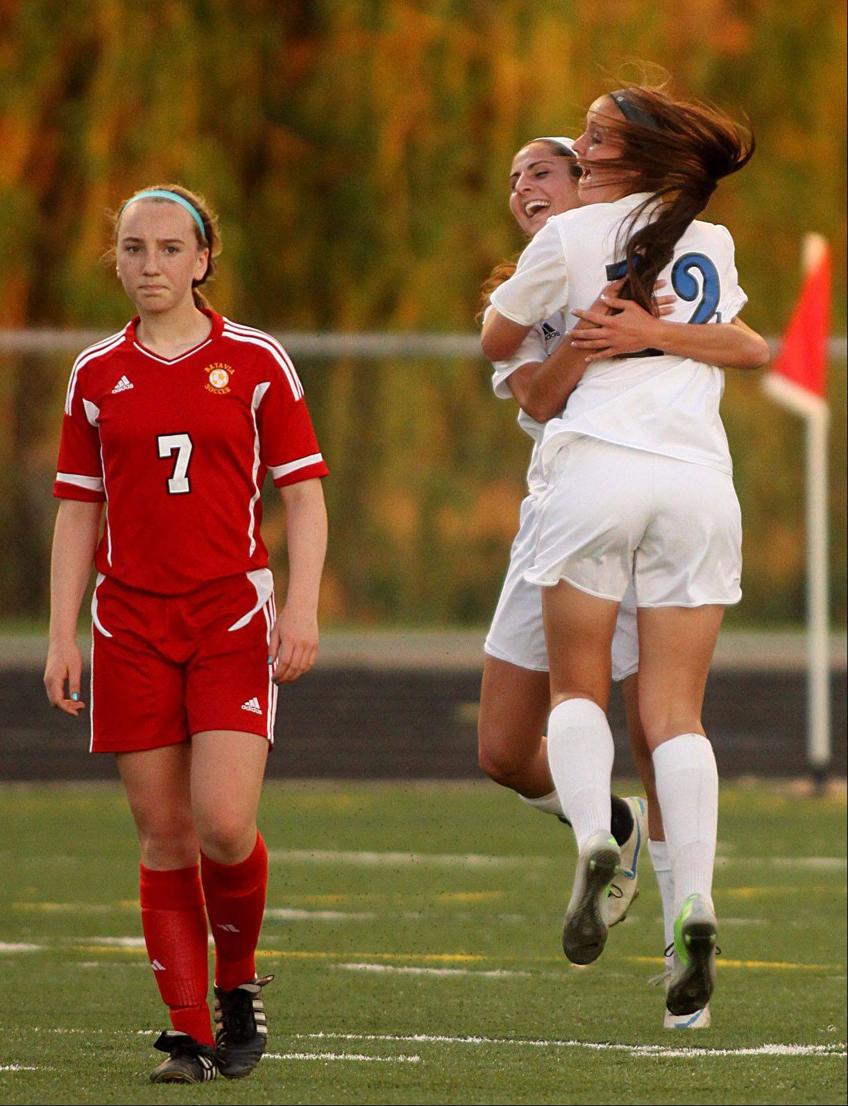 Batavia's Alexis Bryl, left, walks away as Geneva's Maggie Bodine and Molly Axen celebrate a Bodine goal during sectional semifinal play at Hoffman Estates on Tuesday night.