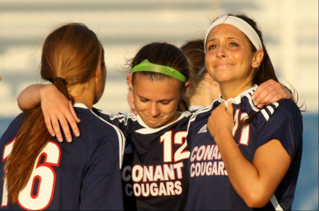 Conant players, from left, Kayla Severinsen, Courtney O'Keeffe, and Alyssa Altosino react after a double-overtime 1-0 loss to St Charles North in sectional semifinal play at Hoffman Estates on Tuesday.