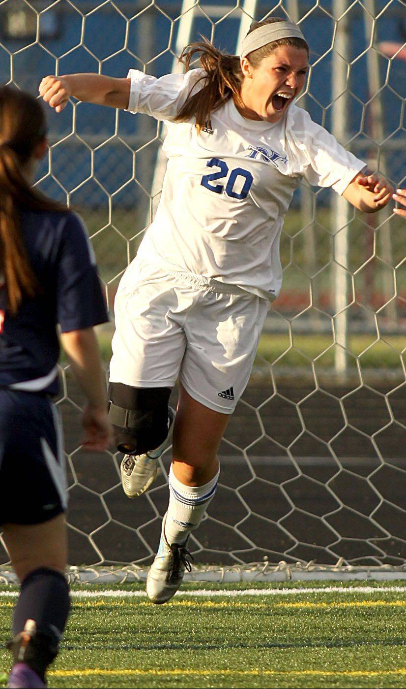 St Charles North's Kenzie Rose celebrates her goal in the second overtime against Conant in sectional at Hoffman Estates on Tuesday.