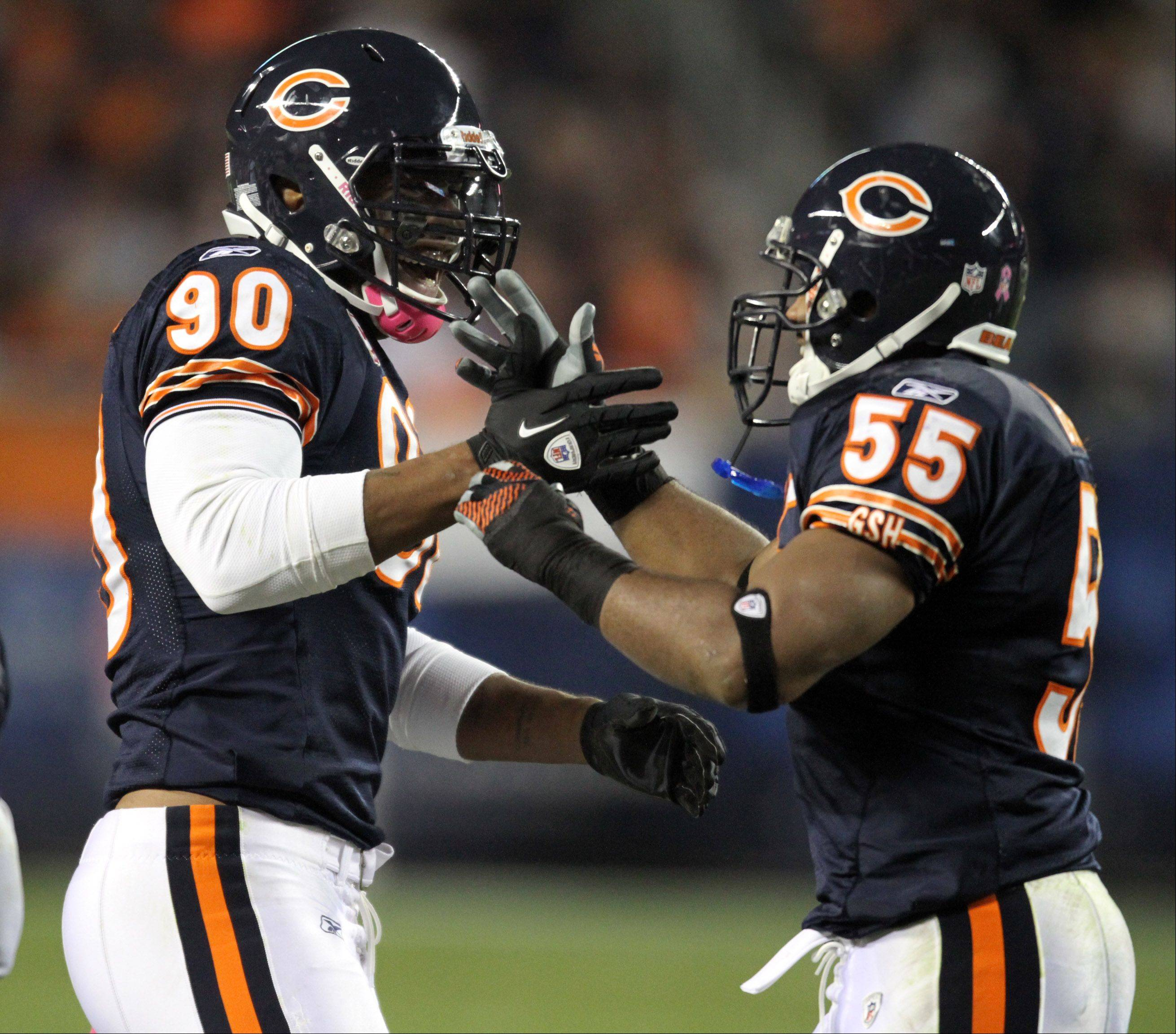George Leclaire/gleclaire@dailyherald.com ¬ Chicago Bears Julius Peppers celebrates, with Lance Briggs, sacking Minnesota Vikings Minnesota Vikings quarterback Donovan McNabb in the third quarter at Soldier Field in Chicago on Sunday, October 16th.