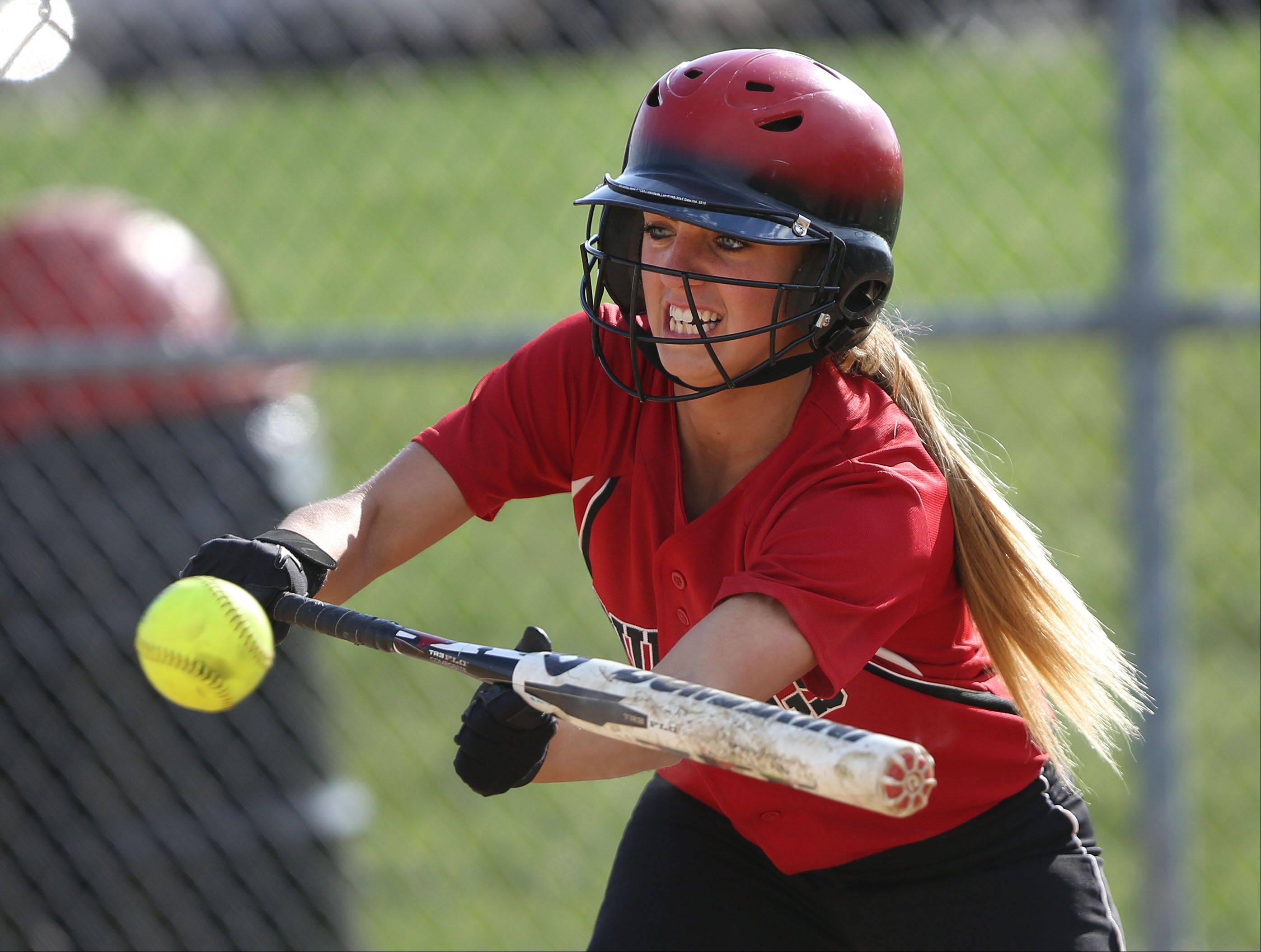Grant's Kaitlyn Wold bunts during the the NSC championship game at Zion-Benton High School Wednesday.