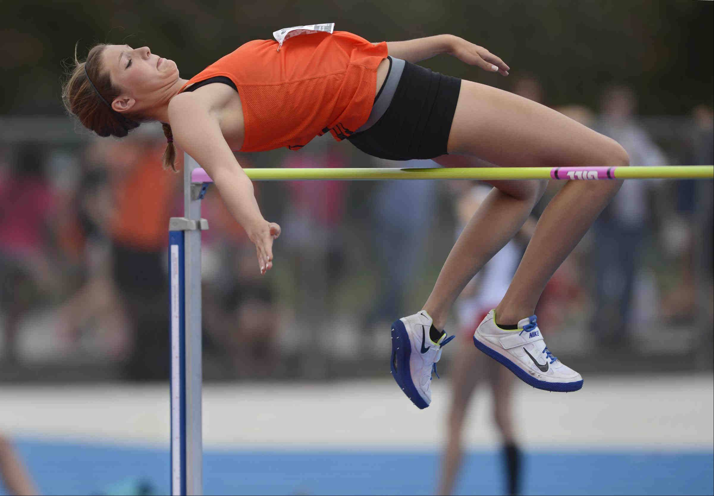 Wheaton Warrenville South's Erin Zappia clears the bar during Friday's high jump event at the Class 3A girls state track and field preliminaries in Charleston.
