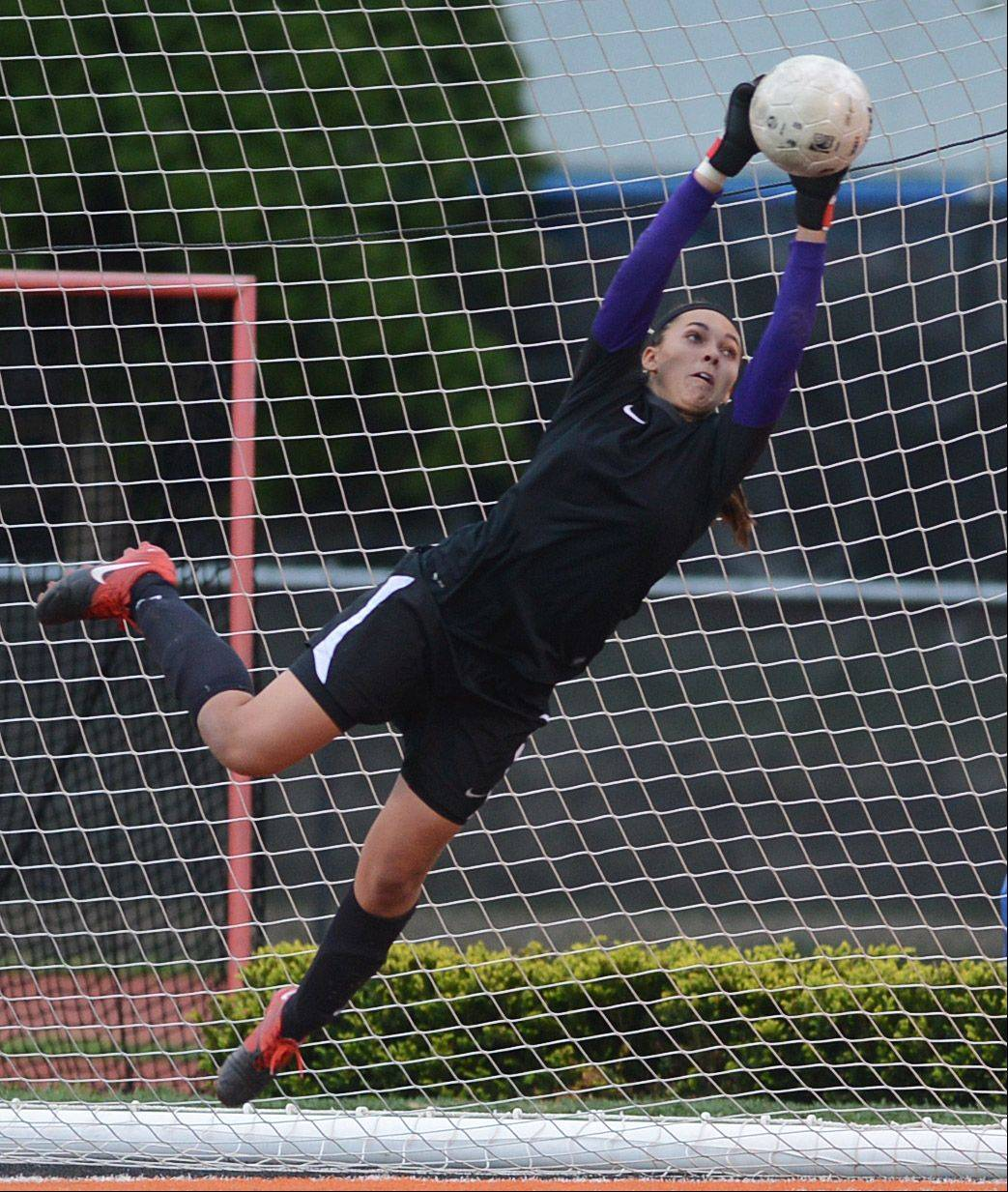 Mundelein goalkeeper Brooke Dennis makes a leaping save against Buffalo Grove during Friday's Class 3A girls soccer regional final at Libertyville High School.
