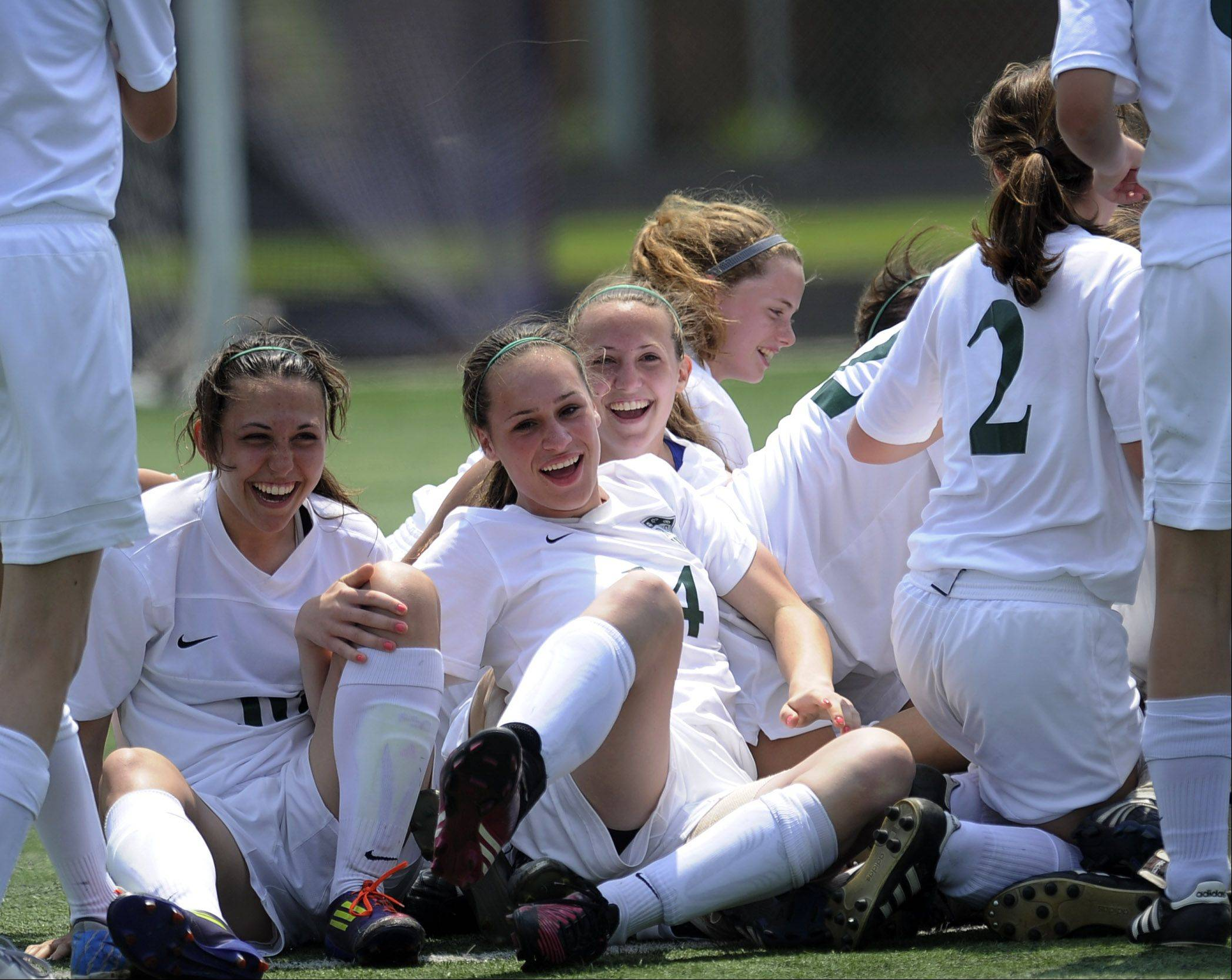 Grayslake Central's Kayley Larson celebrates with teammates after defeating Lakes in a shoot-out during Saturday's Class 2A soccer regional game.