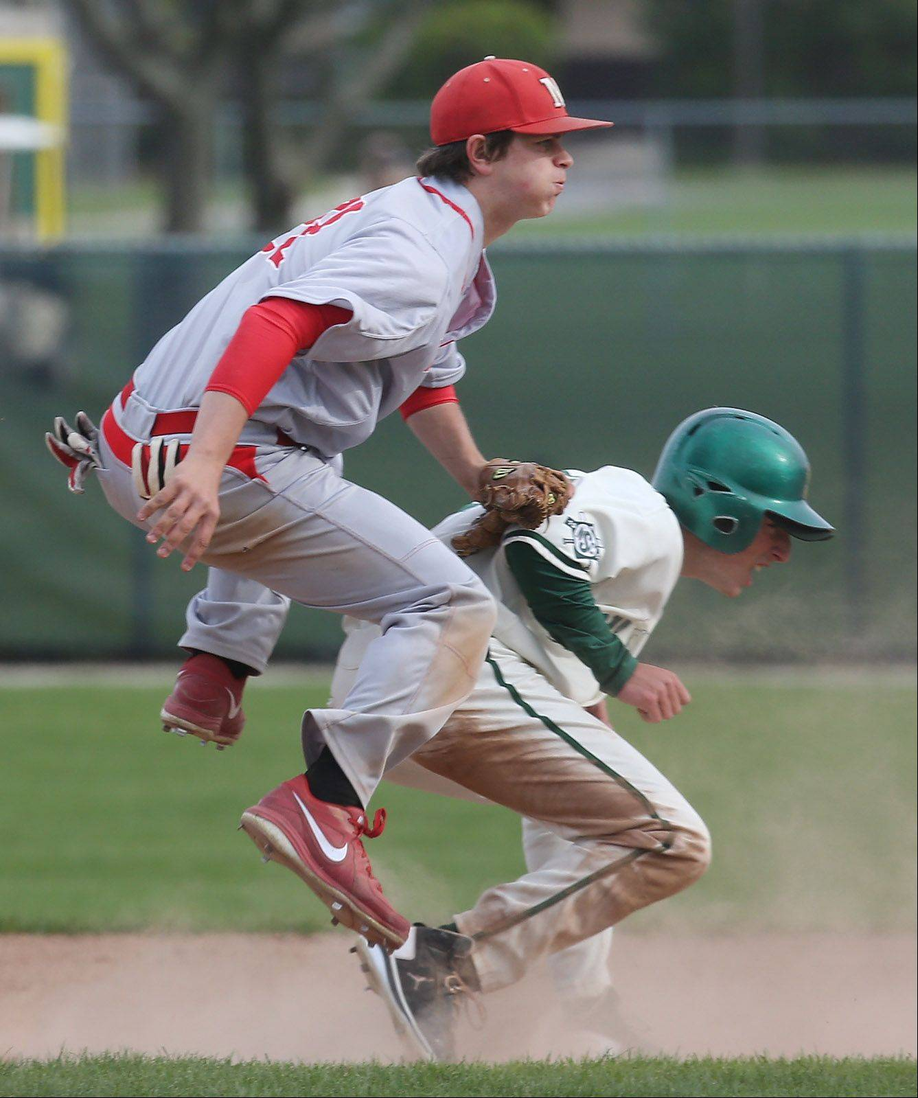 Mundelein's Will Farmer turns the double play after getting Stevenson's Eli Greenspon out at second base on Monday.