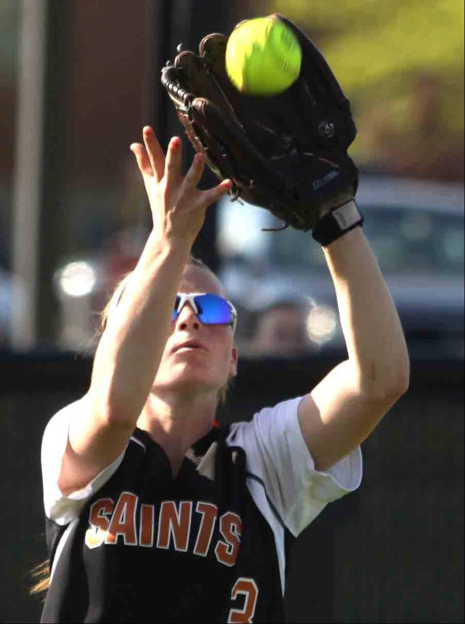 St Charles East's Katie Kolb makes a grab for the out against St. Charles North Tuesday.