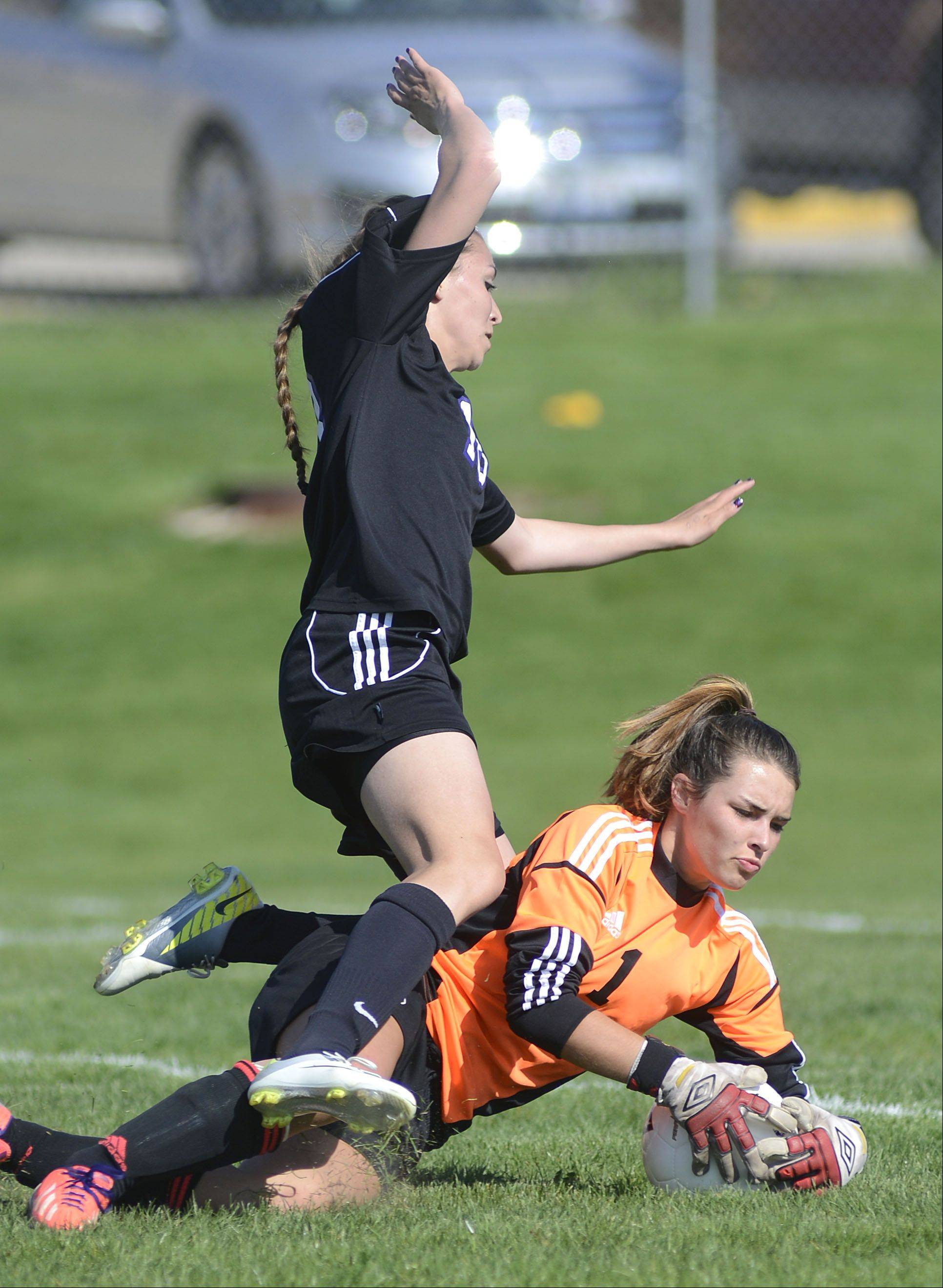 Hampshire's Alexis Maze, top, collides with Burlington Central goalie Taylor Martin during Tuesday's Class 2A regional semifinal.