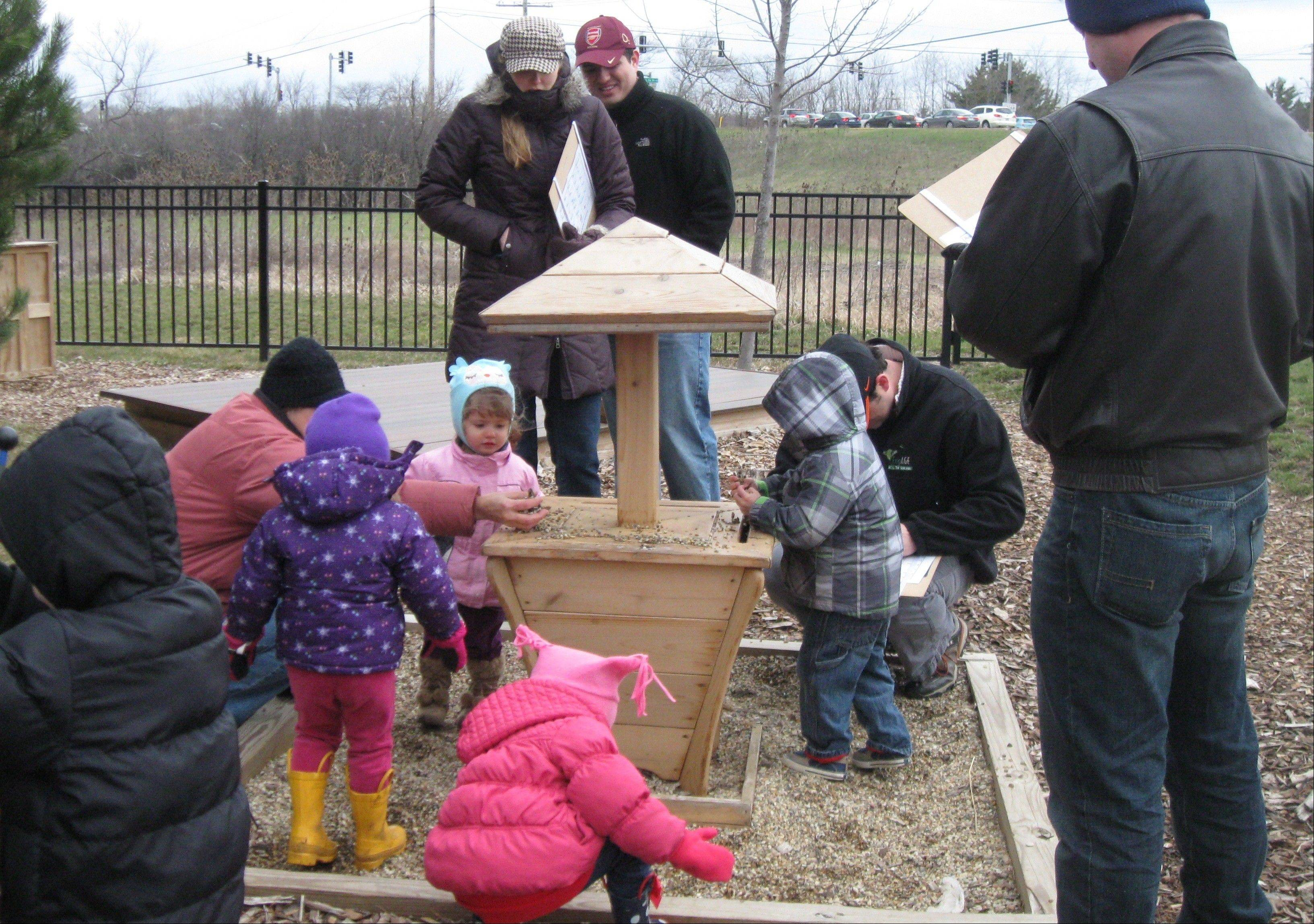 Children search for alphabet related items outdoors while experiencing the beautiful sound of the pebble harp.