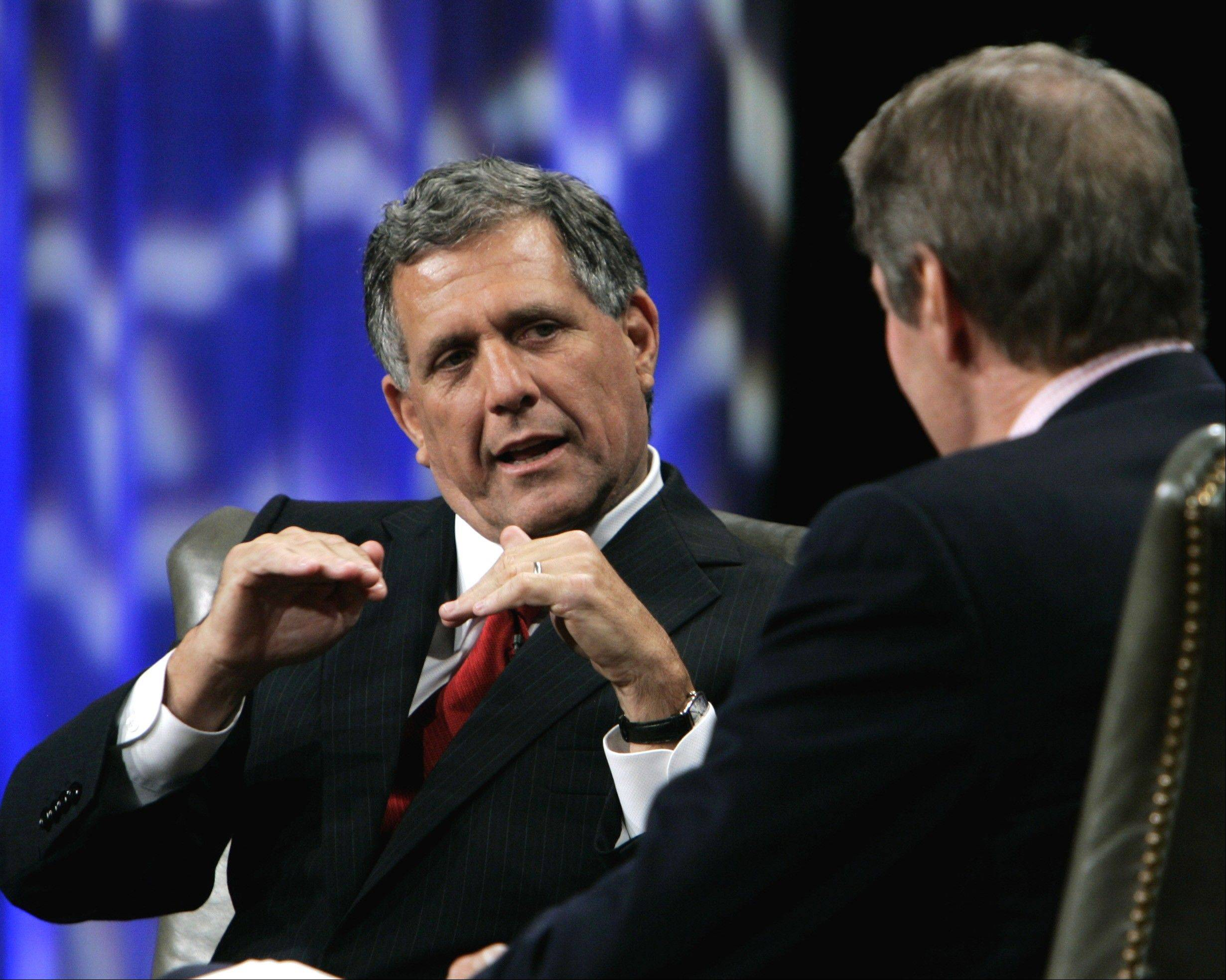 ASSOCIATED PRESS Leslie Moonves, left, president and chief executive officer of CBS, seen with PBS host Charlie Rose, was the highest paid CEO in 2012. He made $60.3 million.