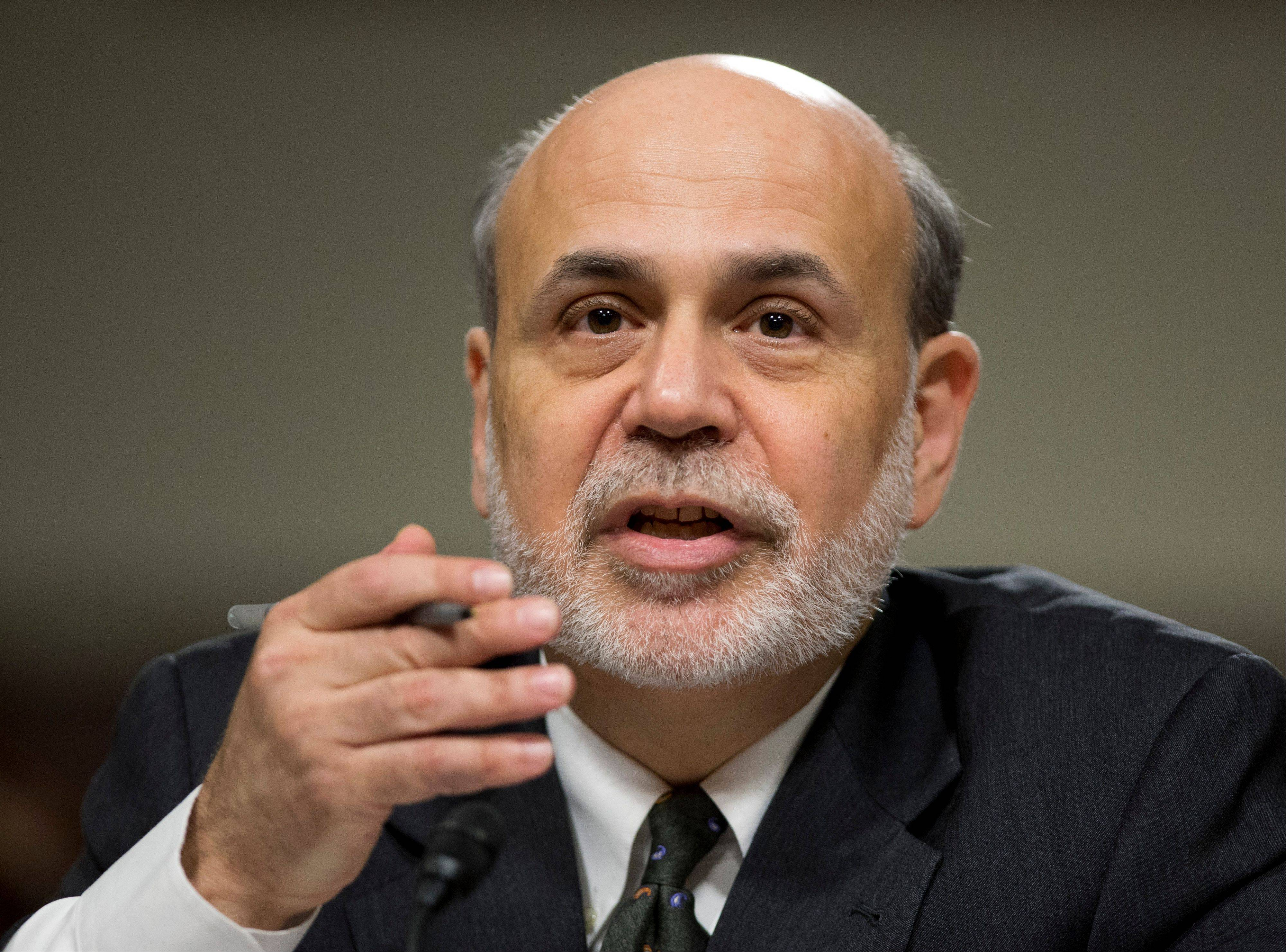 ASSOCIATED PRESS Federal Reserve Chairman Ben Bernanke, testifying on Capitol Hill Wednesday, said the U.S. job market remains weak and it is too soon for the Federal Reserve to end its extraordinary stimulus programs.