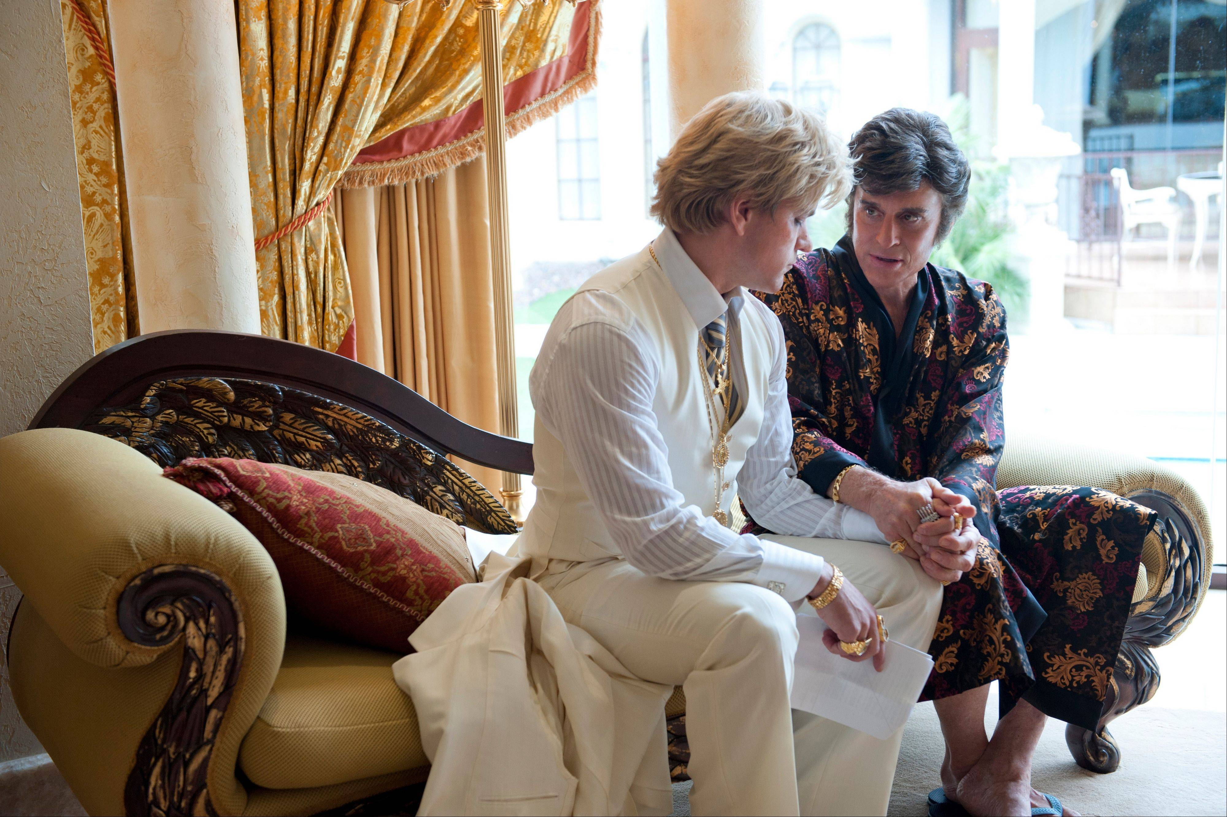 "Michael Douglas, right, as Liberace, and Matt Damon, as Scott Thorson in ""Behind the Candelabra,"" premiering Sunday on HBO."