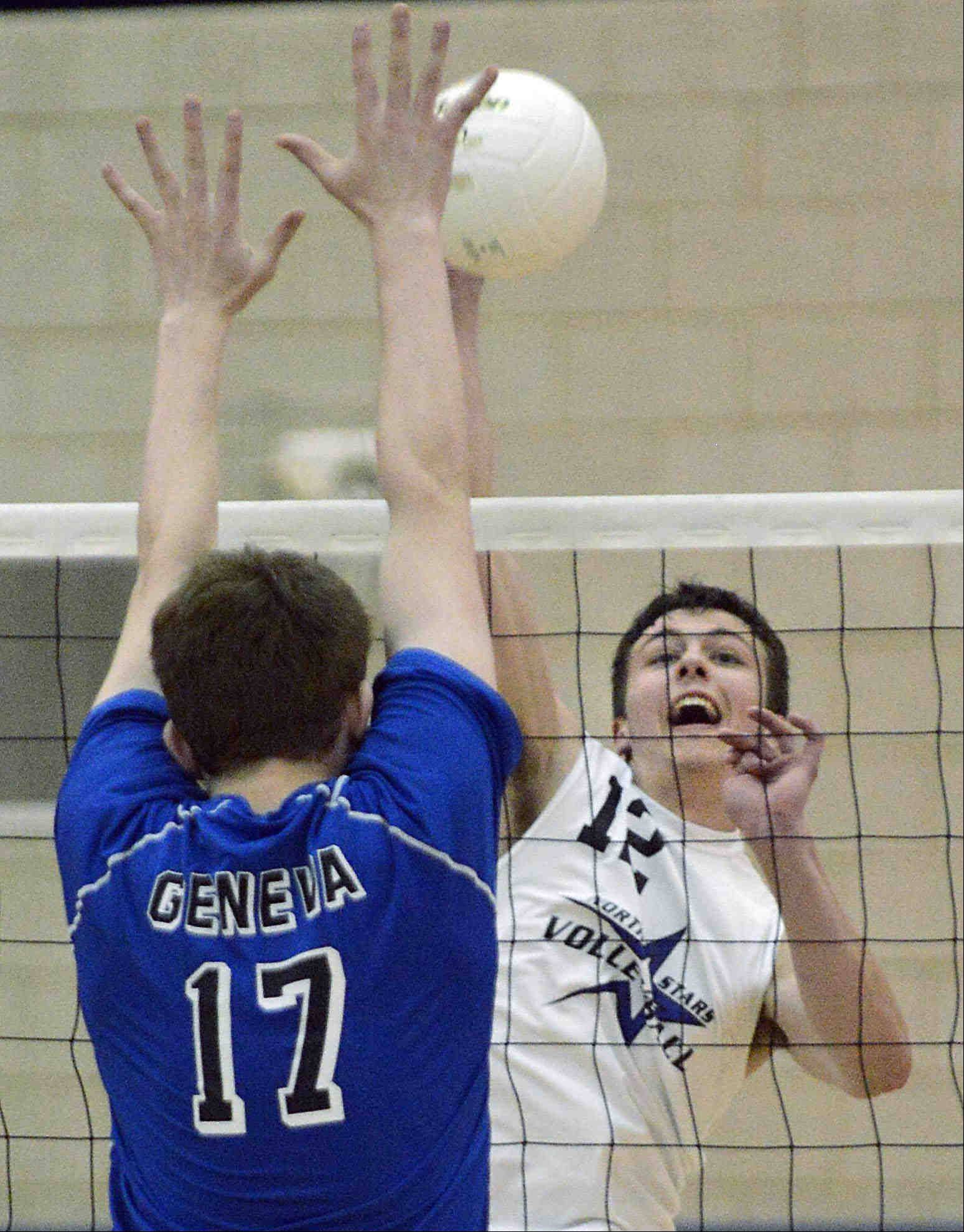 Geneva's St. Charles North's Jake Hamilton sends a shot toward the defense of Geneva's Mason Stierwalt Wednesday at the Geneva regional championship match.