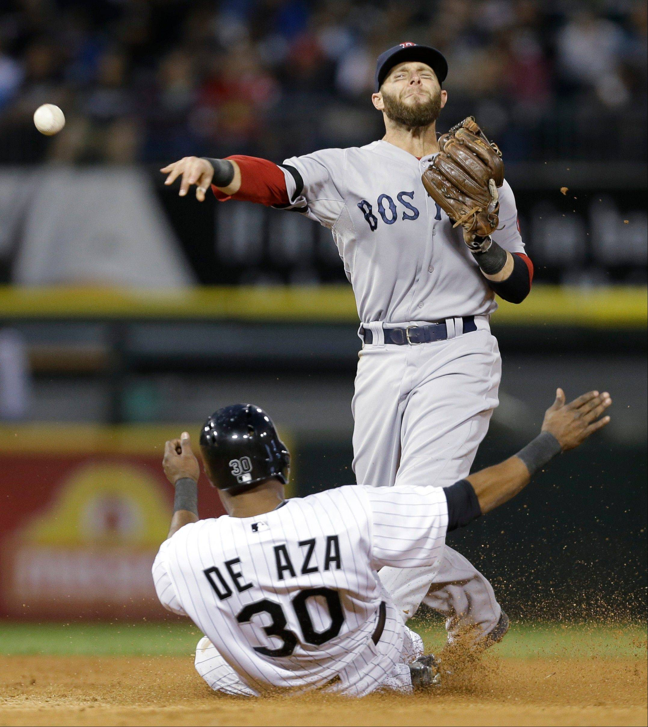 Boston Red Sox second baseman Dustin Pedroia, top, throws to first after forcing out Chicago White Sox's Alejandro De Aza during the third inning of a baseball game in Chicago, Wednesday, May 22, 2013. Alexei Ramirez was safe at first.